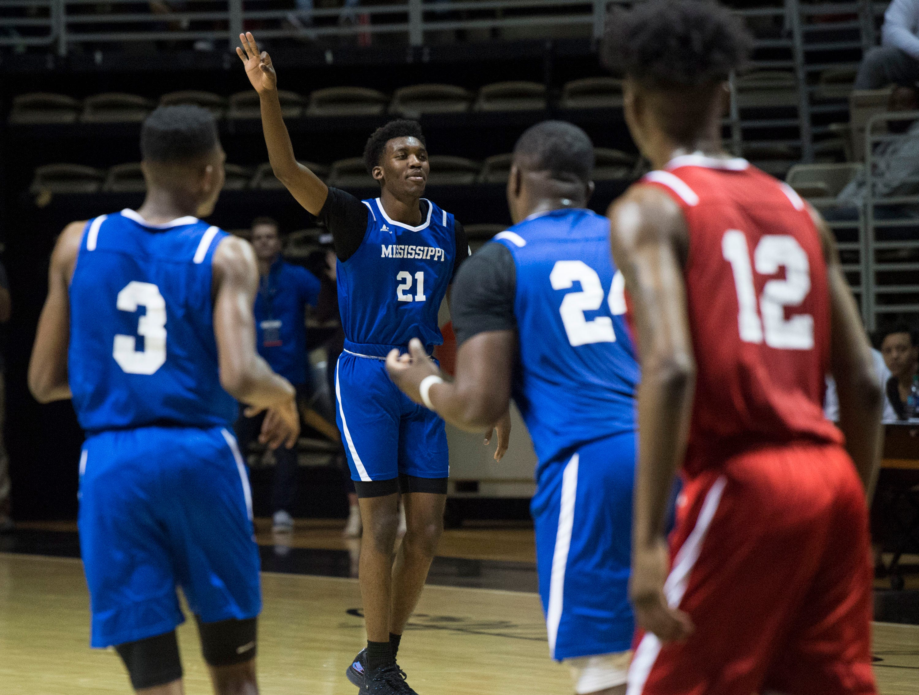 Mississippi's Jaylen Forbes (21) celebrates a three pointer during the Alabama-Mississippi All-Star game at the Dunn-Oliver Acadome in Montgomery, Ala., on Friday, March 15, 2019. Mississippi All-stars leads the Alabama All-stars 47-39 at halftime.