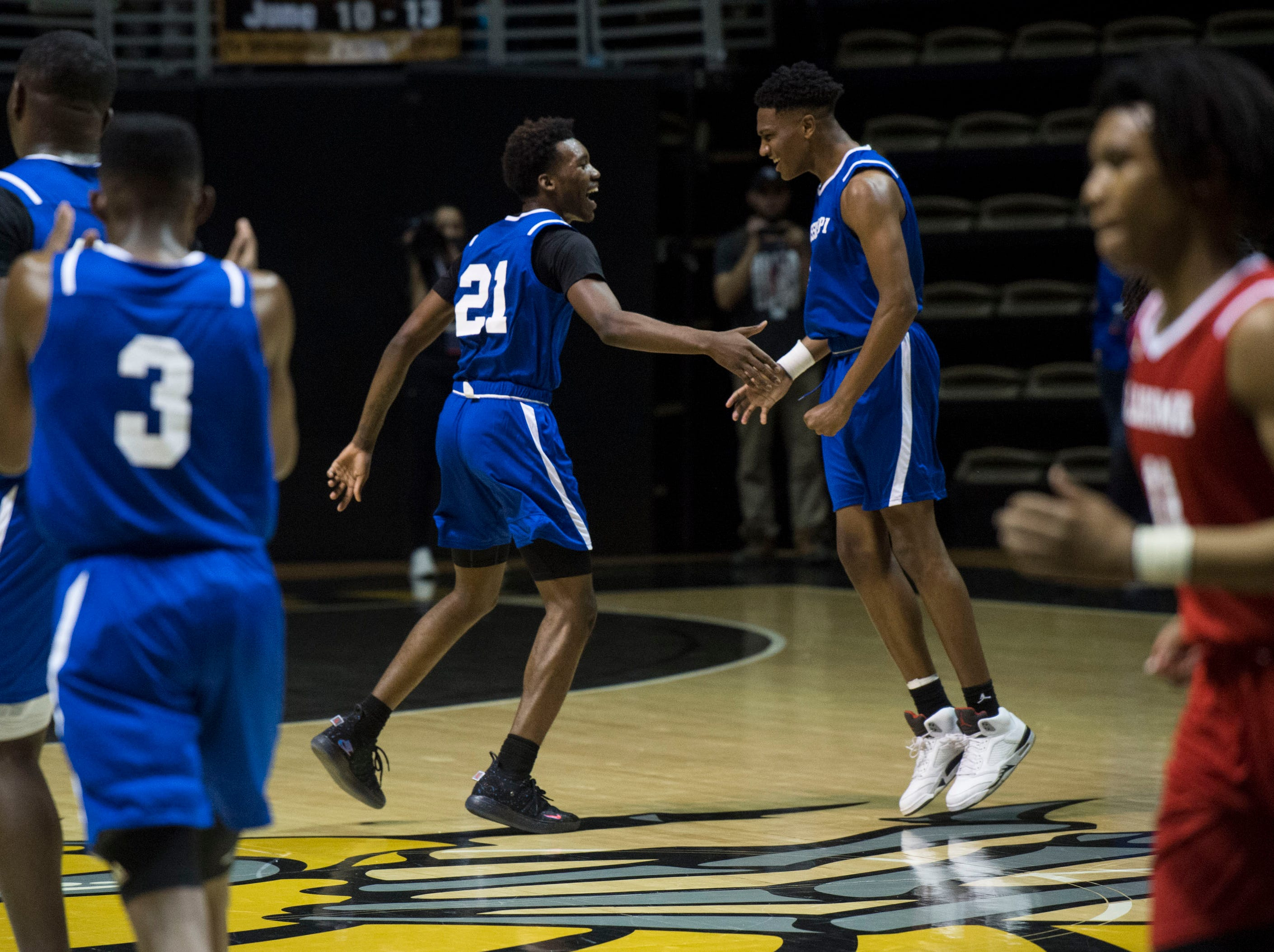 Mississippi's Jaylen Forbes (21) and Brandon Weatherspoon (15) celebrate a play during the Alabama-Mississippi All-Star game at the Dunn-Oliver Acadome in Montgomery, Ala., on Friday, March 15, 2019. Alabama All-stars defeated the Mississippi All-stars 107-90.