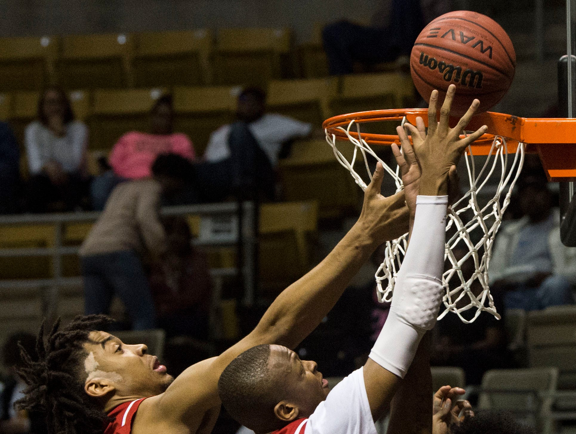 Three Alabama All-star players jump for a rebound during the Alabama-Mississippi All-Star game at the Dunn-Oliver Acadome in Montgomery, Ala., on Friday, March 15, 2019. Mississippi All-stars leads the Alabama All-stars 47-39 at halftime.