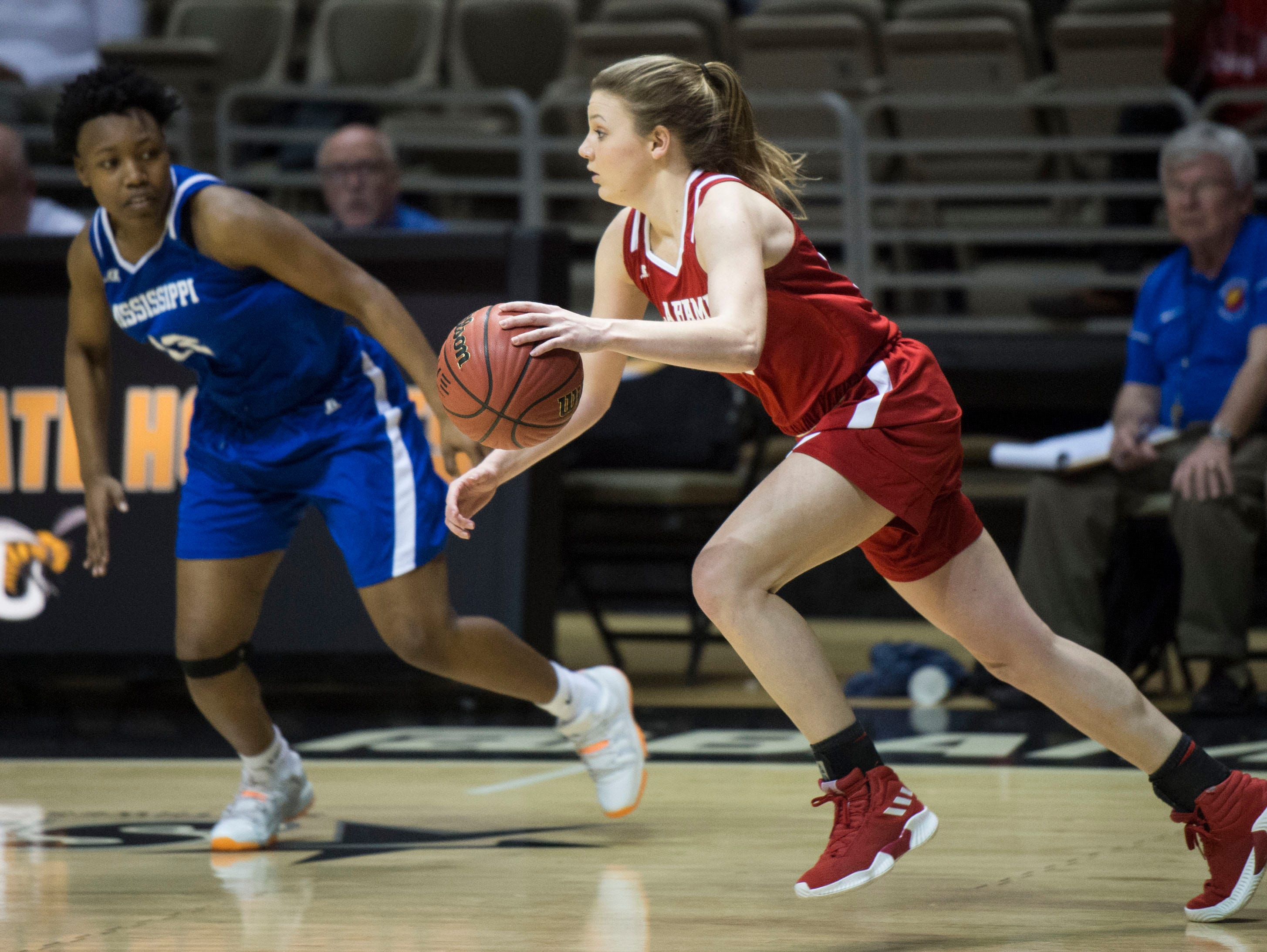 Alabama's Annie Hughes (10) drives the ball up the court during the Alabama-Mississippi All-Star game at the Dunn-Oliver Acadome in Montgomery, Ala., on Friday, March 15, 2019. Alabama All-stars defeated the Mississippi All-stars 101-82.