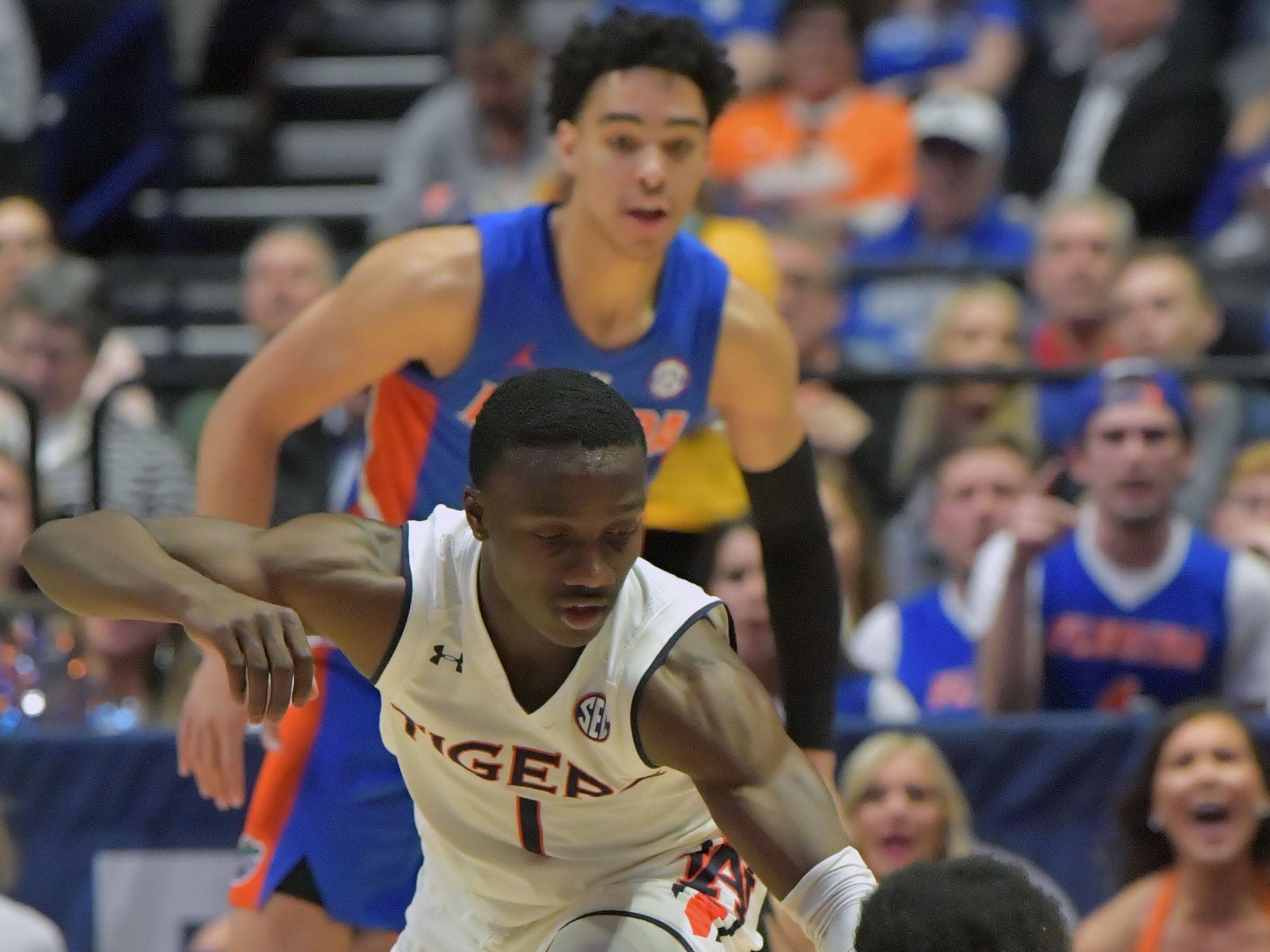 Mar 16, 2019; Nashville, TN, USA; Florida Gators guard KeVaughn Allen (5) dives for the loose ball against Auburn Tigers guard Jared Harper (1) during the first half of game eleven in the SEC conference tournament at Bridgestone Arena. Mandatory Credit: Jim Brown-USA TODAY Sports