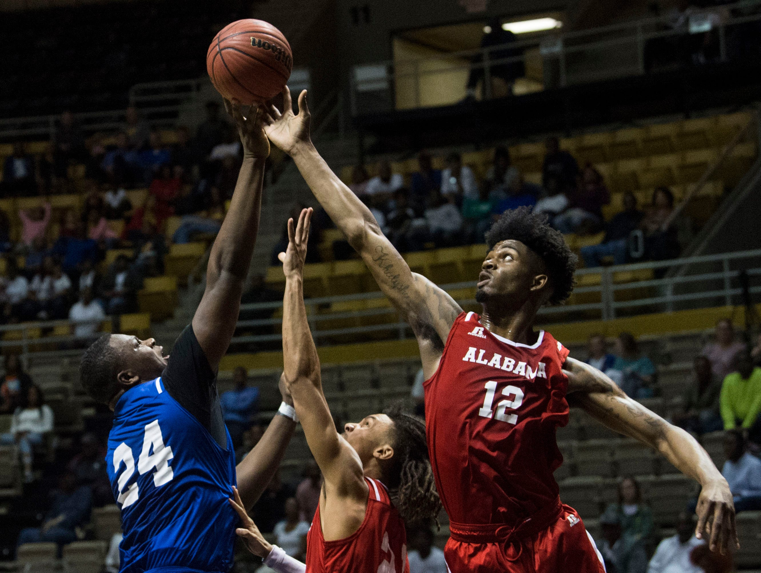 Mississippi's John Rawls (24) and Alabama's DeAntoni Gordon (12) reach for a rebound during the Alabama-Mississippi All-Star game at the Dunn-Oliver Acadome in Montgomery, Ala., on Friday, March 15, 2019. Mississippi All-stars leads the Alabama All-stars 47-39 at halftime.