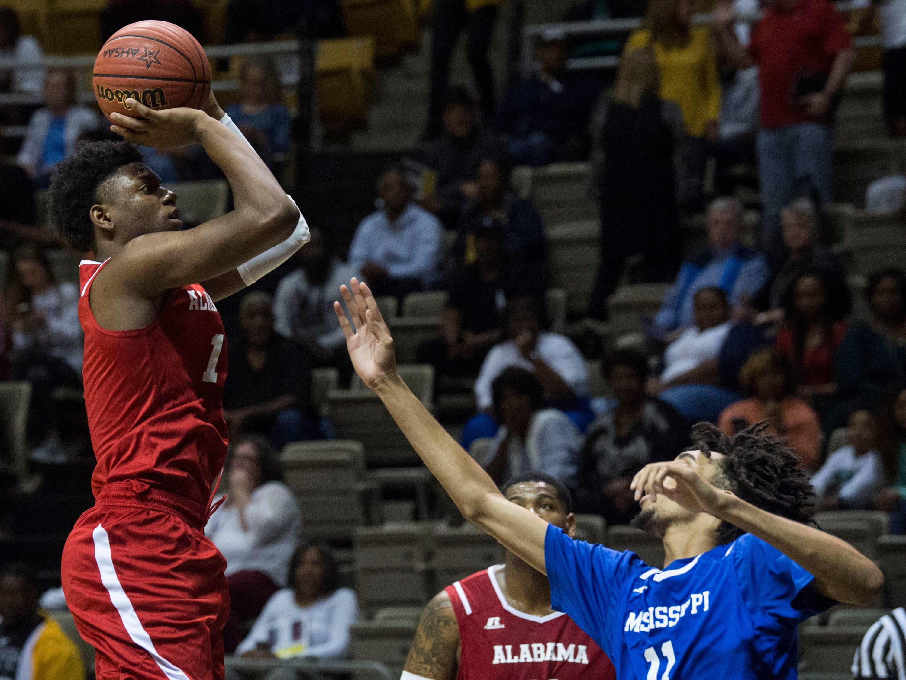 Alabama's Jaykwon Walton (1) takes a jump shot during the Alabama-Mississippi All-Star game at the Dunn-Oliver Acadome in Montgomery, Ala., on Friday, March 15, 2019. Mississippi All-stars leads the Alabama All-stars 47-39 at halftime.