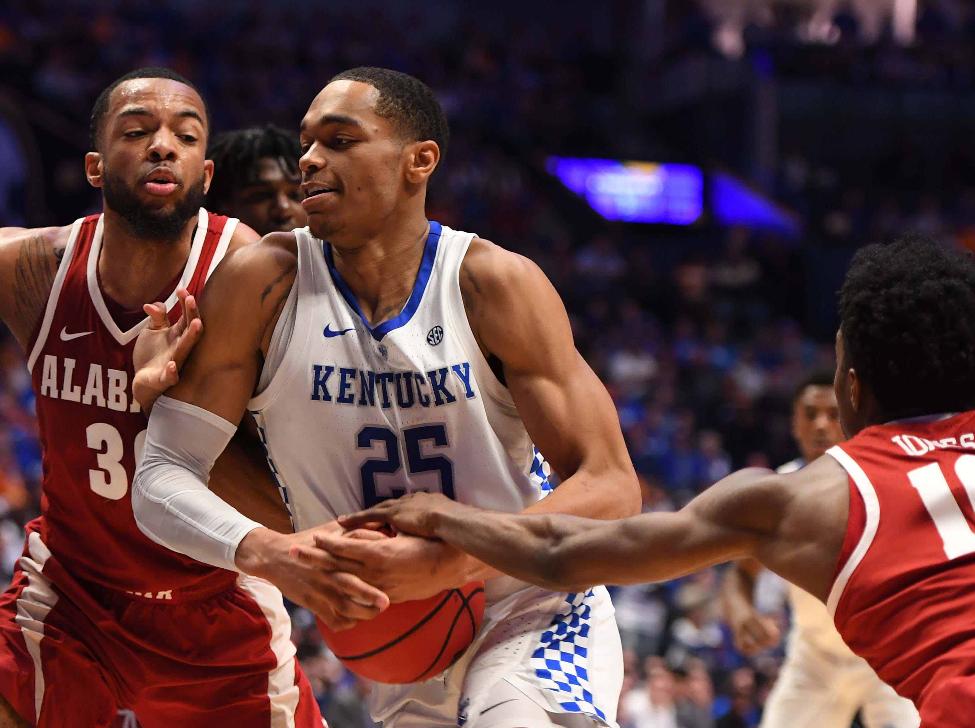 Mar 15, 2019; Nashville, TN, USA; Kentucky Wildcats forward PJ Washington (25) drives to the basket against the Alabama Crimson Tide during the first half of the SEC conference tournament at Bridgestone Arena. Mandatory Credit: Christopher Hanewinckel-USA TODAY Sports
