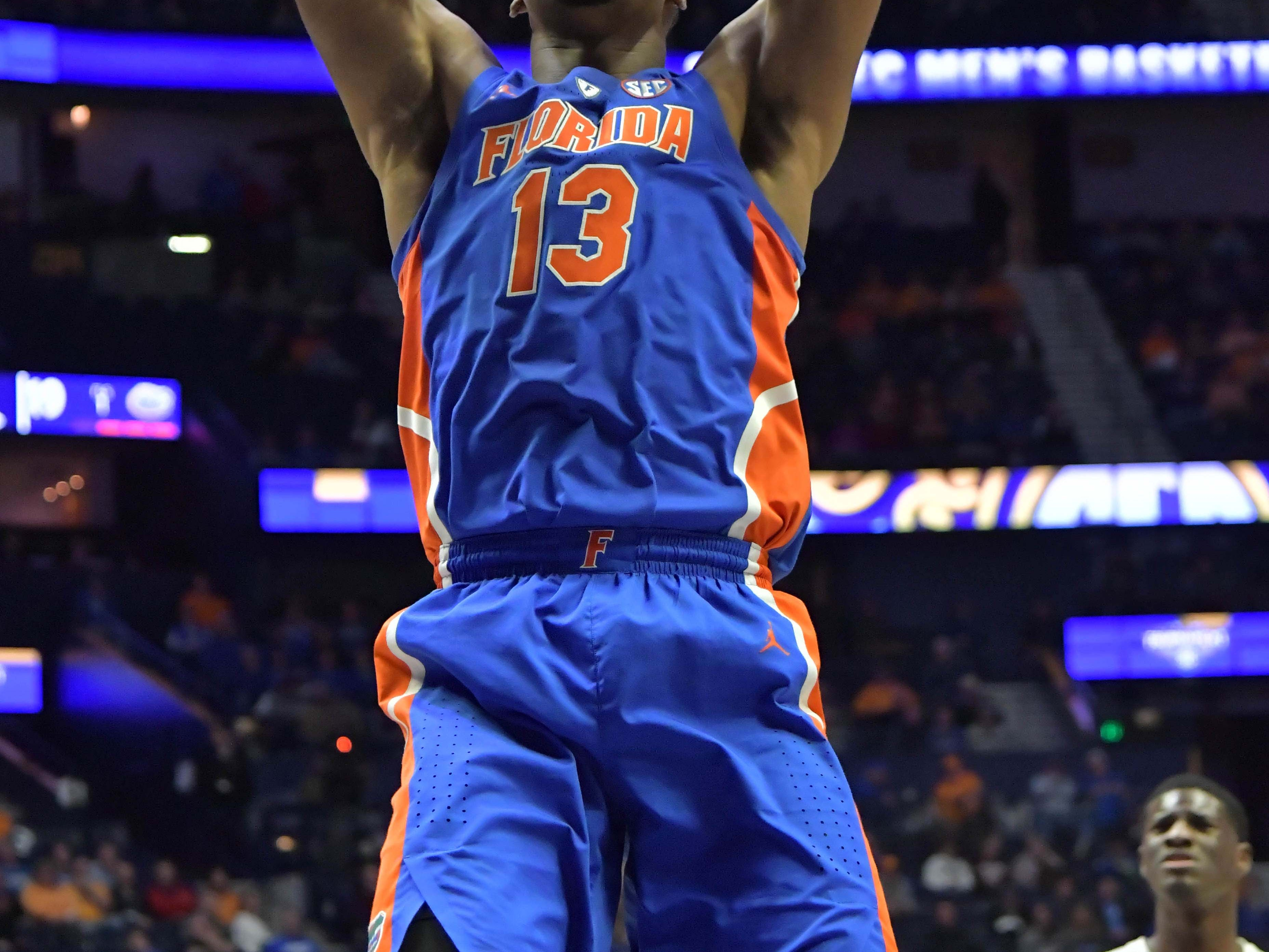 Mar 16, 2019; Nashville, TN, USA; Florida Gators center Kevarrius Hayes (13) dunks the ball against the Auburn Tigers during the first half of game eleven in the SEC conference tournament at Bridgestone Arena. Mandatory Credit: Jim Brown-USA TODAY Sports