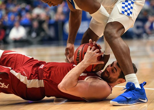 Mar 15, 2019; Nashville, TN, USA; Alabama Crimson Tide guard Riley Norris (1) holds onto the ball for a jump ball against the Kentucky Wildcats during the first half of the SEC conference tournament at Bridgestone Arena. Mandatory Credit: Christopher Hanewinckel-USA TODAY Sports