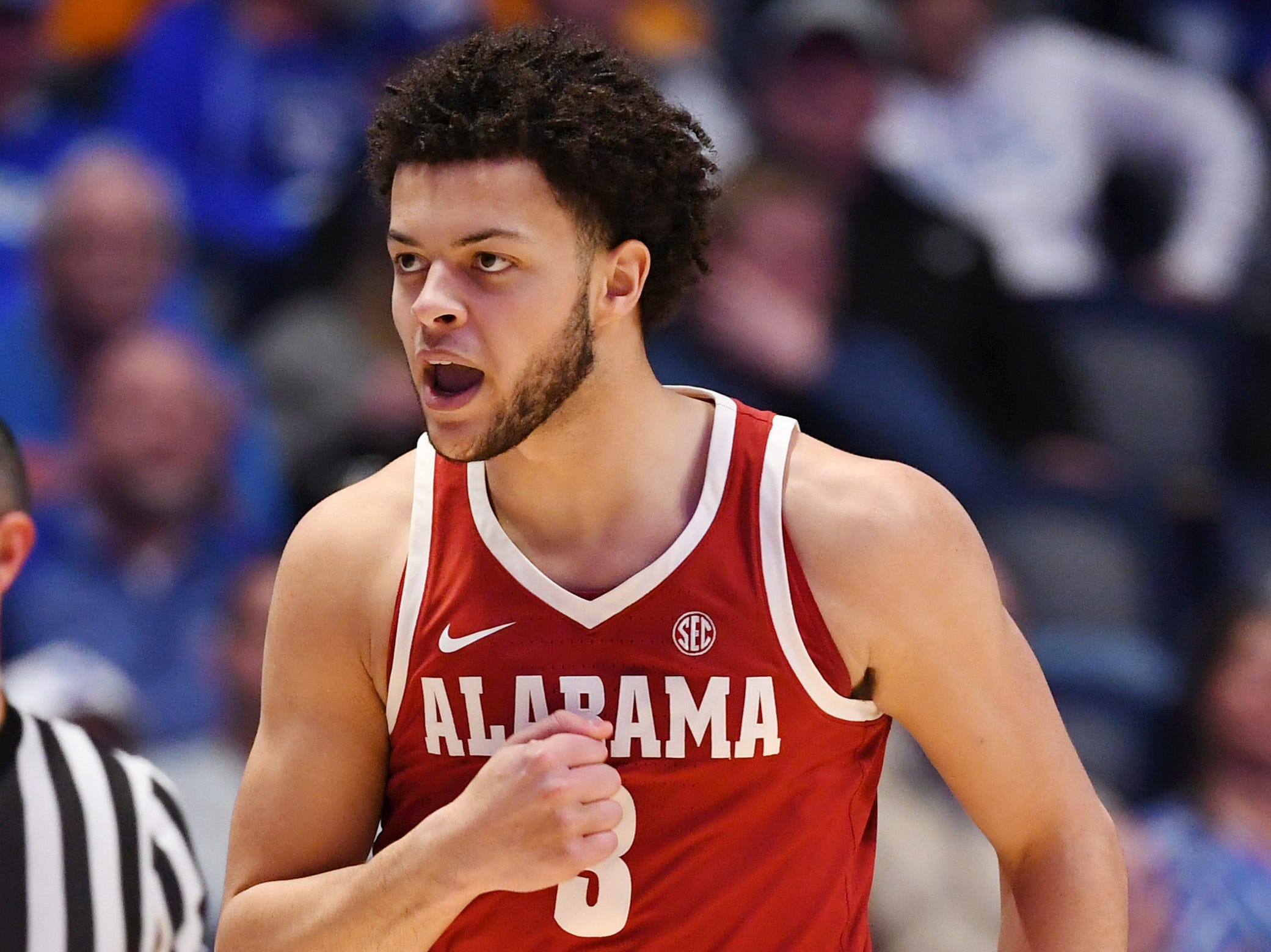 Mar 15, 2019; Nashville, TN, USA; Alabama Crimson Tide forward Alex Reese (3) celebrates after scoring a three point basket against the Kentucky Wildcats during the first half of the SEC conference tournament at Bridgestone Arena. Mandatory Credit: Christopher Hanewinckel-USA TODAY Sports