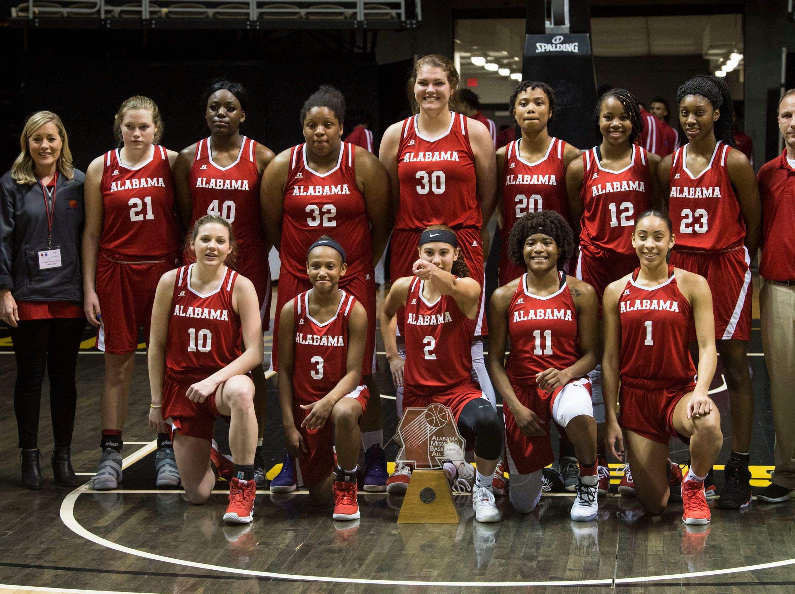 Alabama All-Star team poses with the trophy during the Alabama-Mississippi All-Star game at the Dunn-Oliver Acadome in Montgomery, Ala., on Friday, March 15, 2019. Alabama All-stars defeated the Mississippi All-stars 101-82.