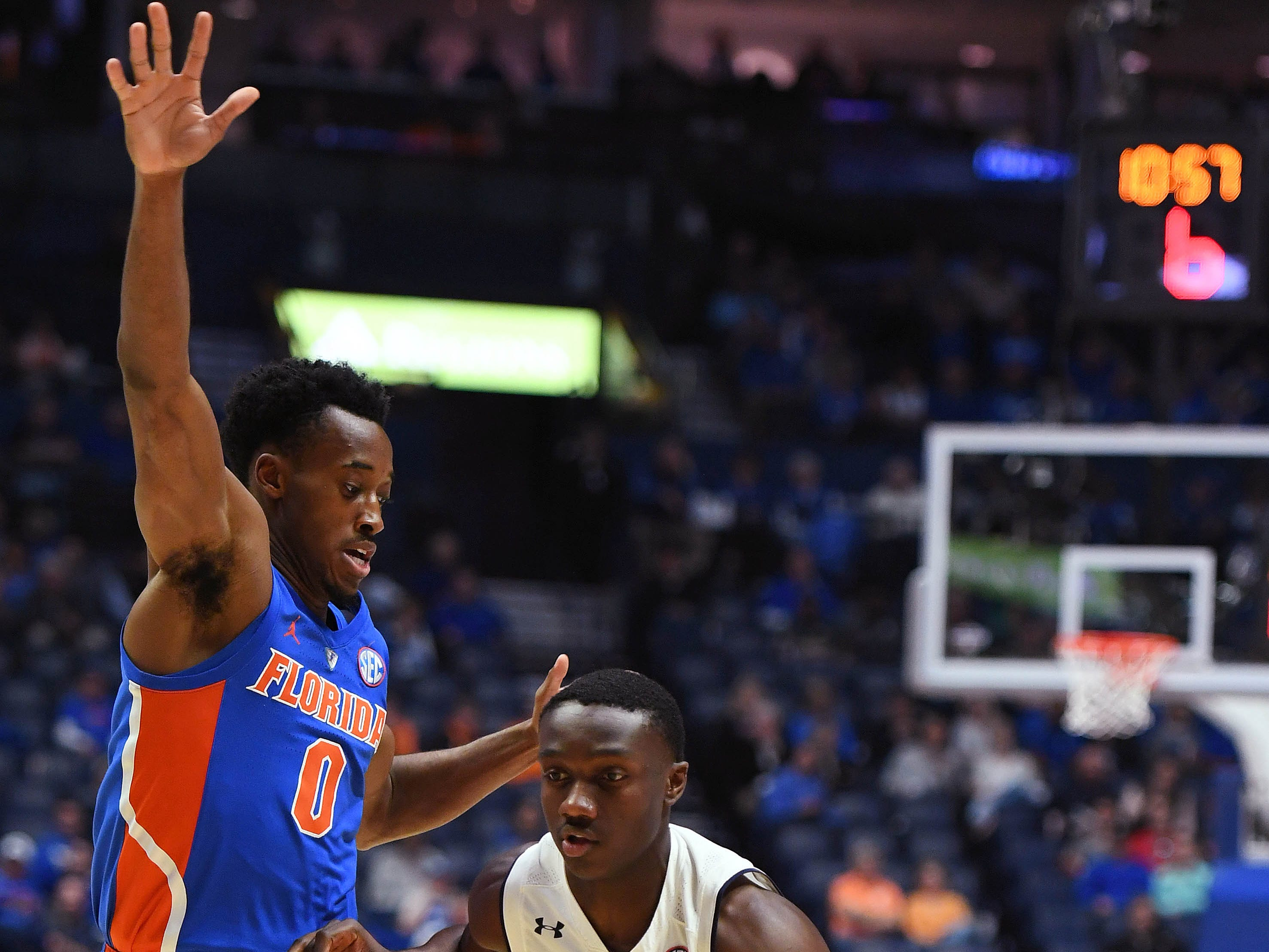 Mar 16, 2019; Nashville, TN, USA; Auburn Tigers guard Jared Harper (1) dribbles the ball as Florida Gators guard Mike Okauru (0) defends during the first half of the SEC conference tournament at Bridgestone Arena. Mandatory Credit: Christopher Hanewinckel-USA TODAY Sports