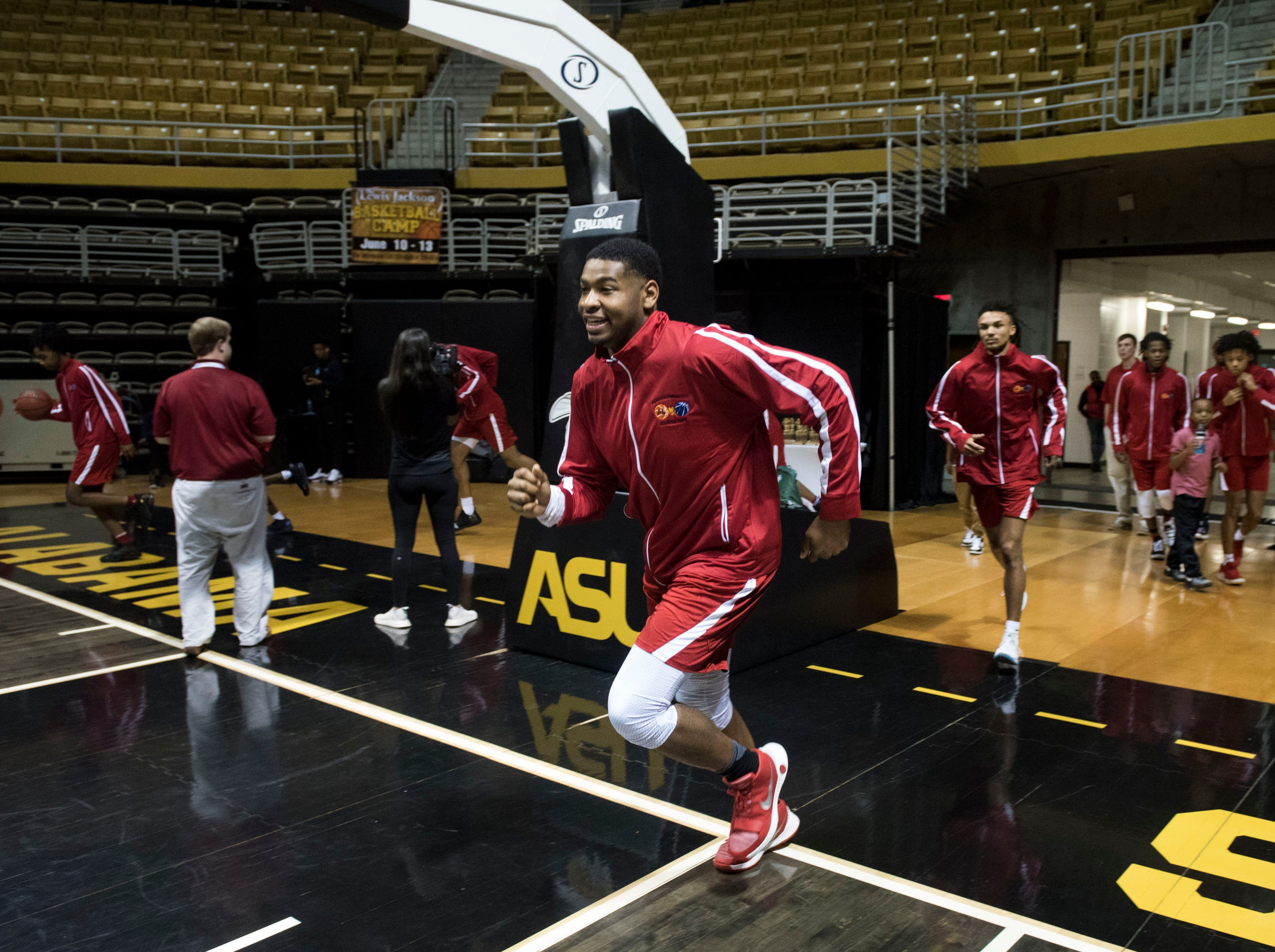 Alabama's Demond Robinson runs onto the court with his team during the Alabama-Mississippi All-Star game at the Dunn-Oliver Acadome in Montgomery, Ala., on Friday, March 15, 2019. Alabama All-stars defeated the Mississippi All-stars 107-90.