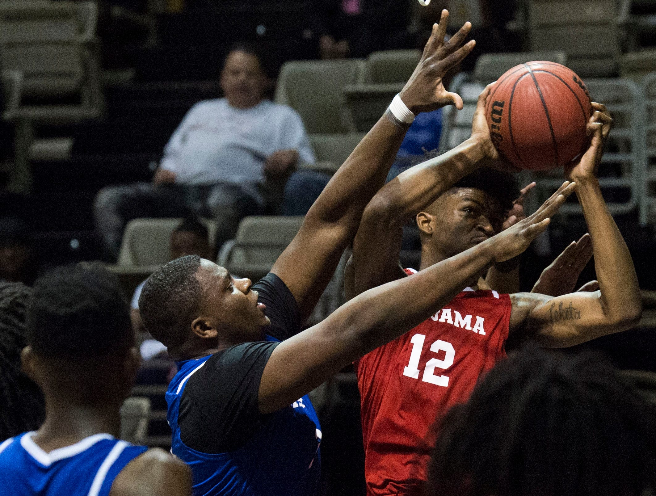 Alabama's DeAntoni Gordon (12) goes up for a layup during the Alabama-Mississippi All-Star game at the Dunn-Oliver Acadome in Montgomery, Ala., on Friday, March 15, 2019. Mississippi All-stars leads the Alabama All-stars 47-39 at halftime.