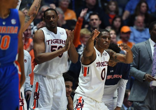 Auburn's Horace Spencer (0) Austin Wiley (50) celebrate on the bench after a basket during the second half against Florida in the SEC Tournament on March 16, 2019.
