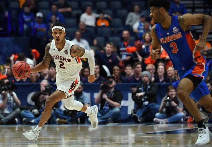 Mar 16, 2019; Nashville, TN, USA; Auburn Tigers guard Bryce Brown (2) dribbles the ball during the first half against the Florida Gators in the SEC conference tournament at Bridgestone Arena. Mandatory Credit: Christopher Hanewinckel-USA TODAY Sports