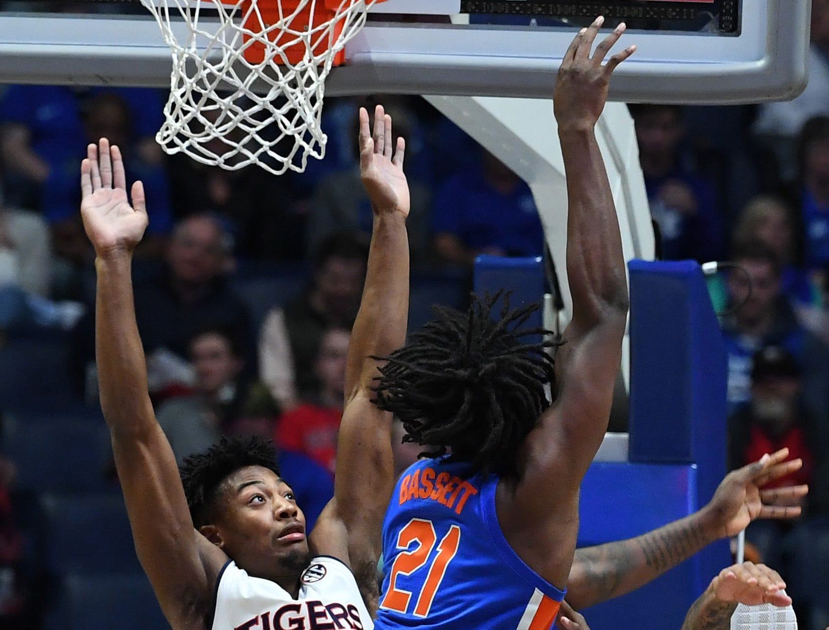 Mar 16, 2019; Nashville, TN, USA; Florida Gators forward Dontay Bassett (21) shoots the ball past Auburn Tigers forward Anfernee McLemore (24) during the first half of the SEC conference tournament at Bridgestone Arena. Mandatory Credit: Christopher Hanewinckel-USA TODAY Sports