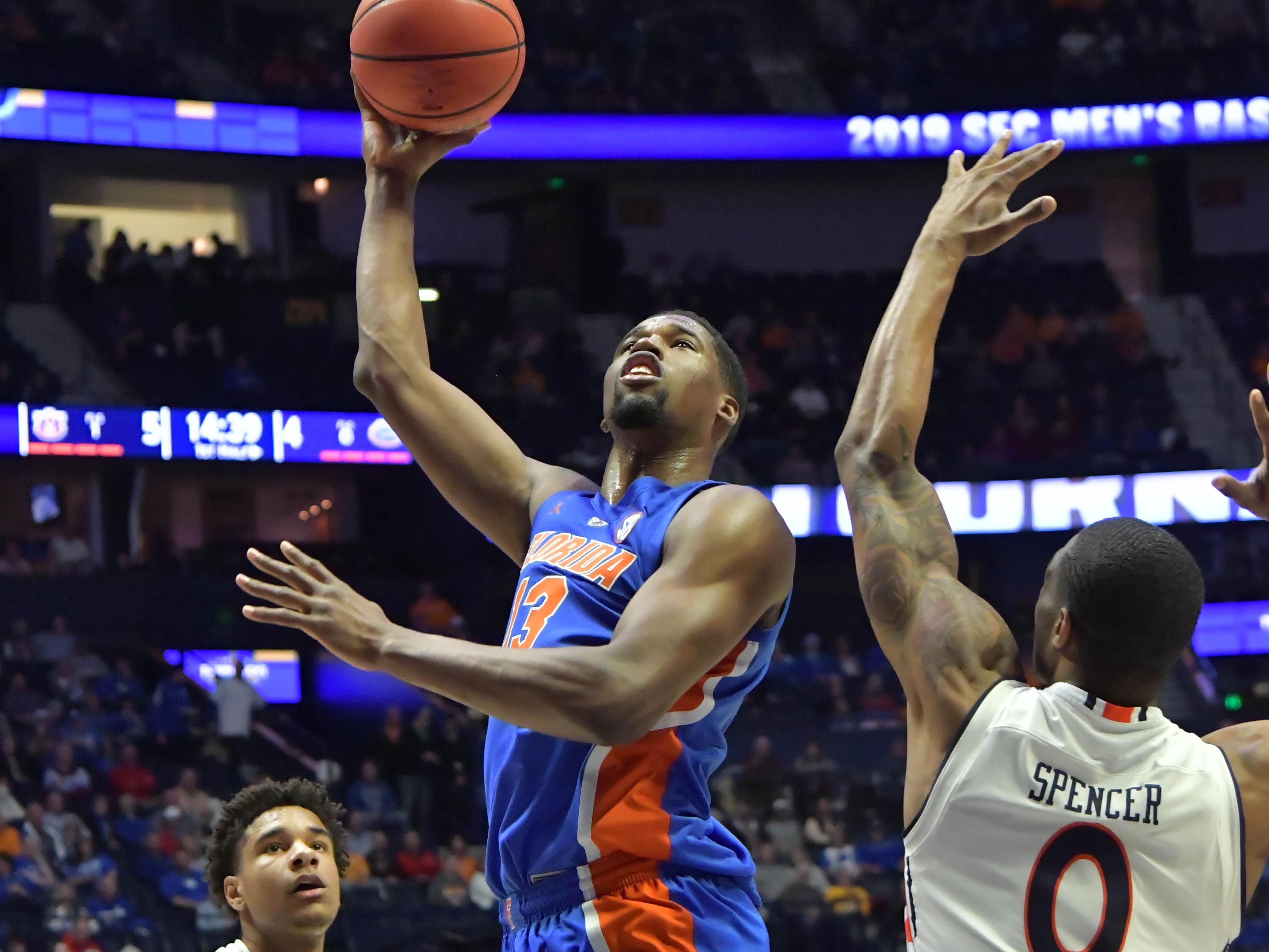 Mar 16, 2019; Nashville, TN, USA; Florida Gators center Kevarrius Hayes (13) shoots againstAuburn Tigers forward Horace Spencer (0) during the first half of game eleven in the SEC conference tournament at Bridgestone Arena. Mandatory Credit: Jim Brown-USA TODAY Sports
