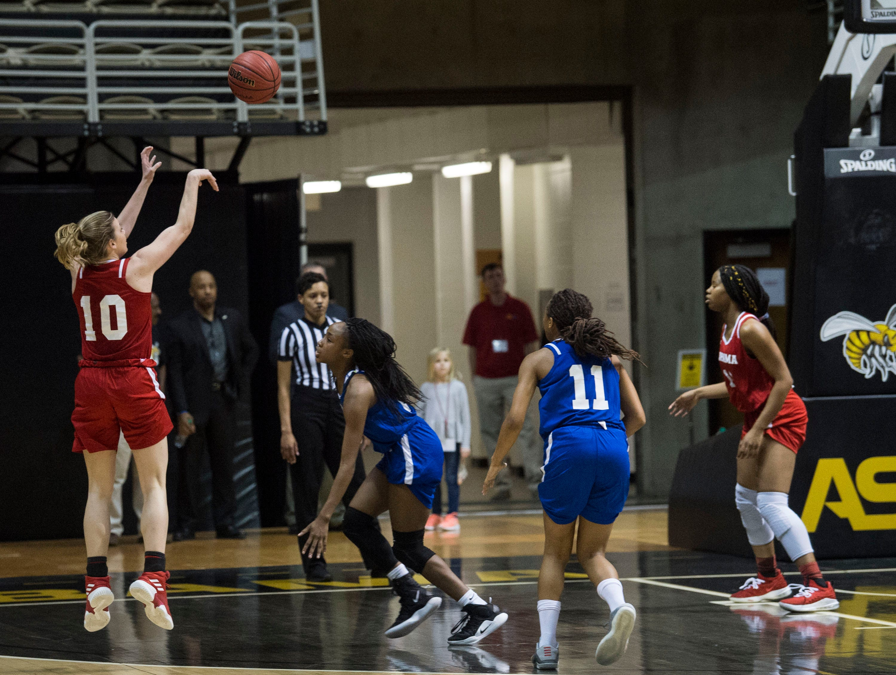 Alabama's Annie Hughes (10) takes a three pointer during the Alabama-Mississippi All-Star game at the Dunn-Oliver Acadome in Montgomery, Ala., on Friday, March 15, 2019. Alabama All-stars defeated the Mississippi All-stars 101-82.