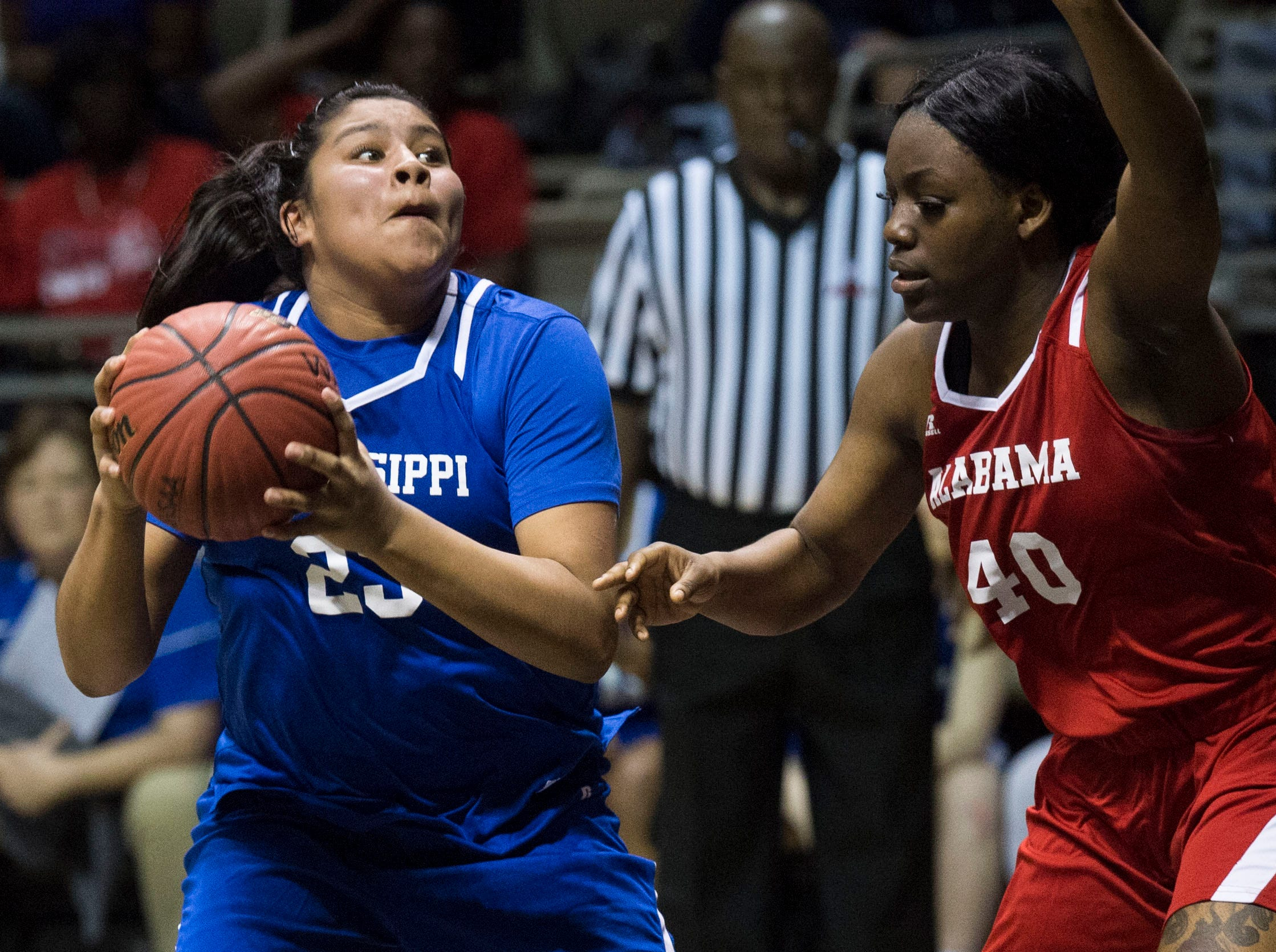 Mississippi's Kaedre Denson (23) looks to go up covered by Alabama's Thaniya Marks (40) during the Alabama-Mississippi All-Star game at the Dunn-Oliver Acadome in Montgomery, Ala., on Friday, March 15, 2019. Alabama All-stars defeated the Mississippi All-stars 101-82.