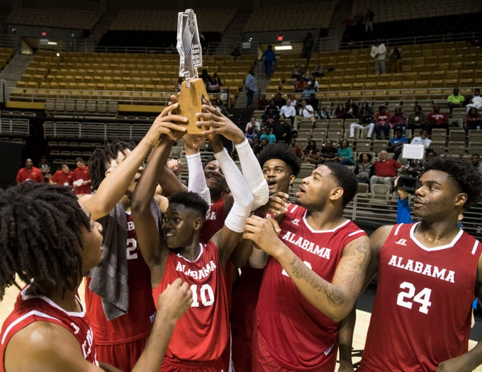 Alabama All-Stars hoist up the trophy after the Alabama-Mississippi All-Star game at the Dunn-Oliver Acadome in Montgomery, Ala., on Friday, March 15, 2019. Alabama All-stars defeated the Mississippi All-stars 107-90.