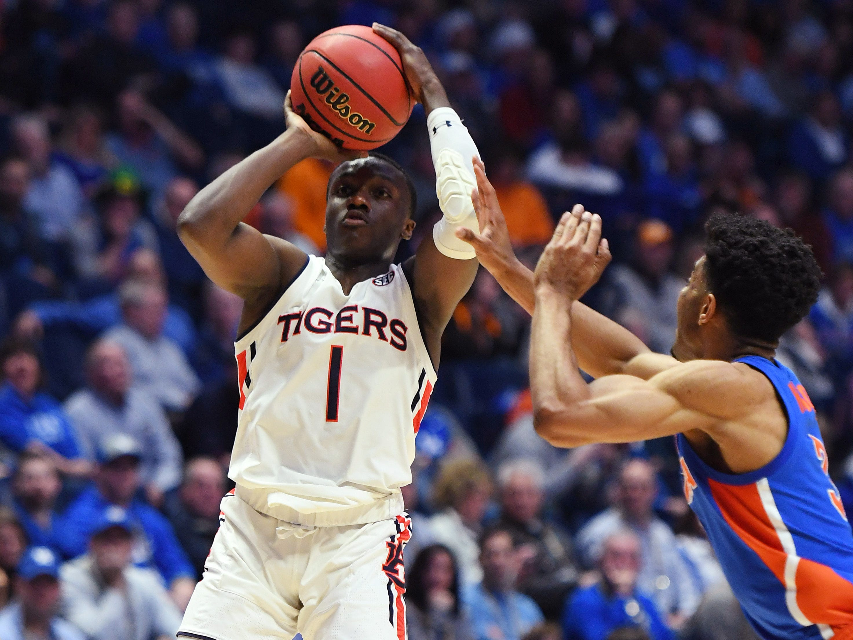 Mar 16, 2019; Nashville, TN, USA; Auburn Tigers guard Jared Harper (1) shoots the ball against the Florida Gators during the first half of the SEC conference tournament at Bridgestone Arena. Mandatory Credit: Christopher Hanewinckel-USA TODAY Sports