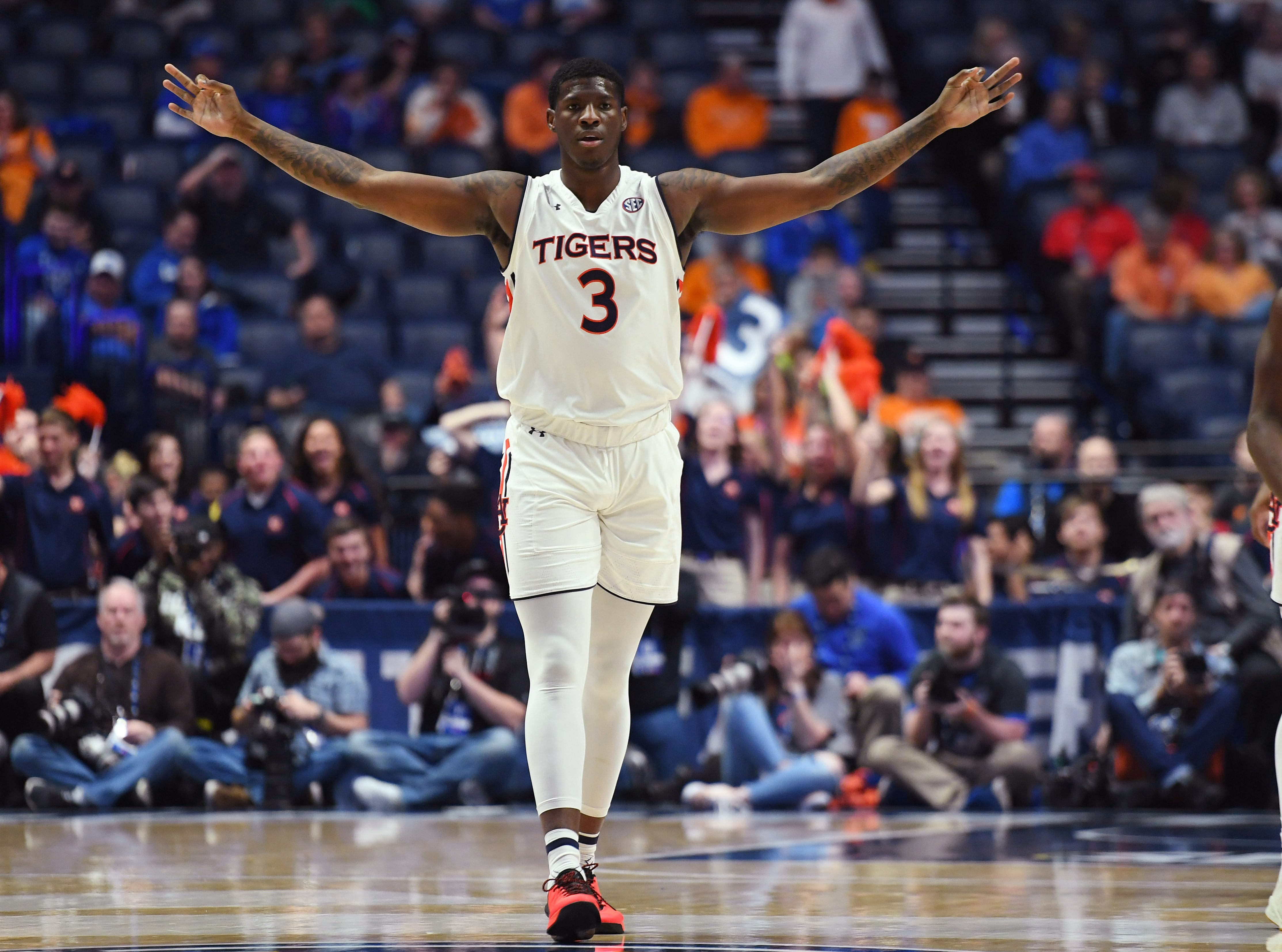 Mar 16, 2019; Nashville, TN, USA; Auburn Tigers forward Danjel Purifoy (3) celebrates after scoring during the first half against the Florida Gators in the SEC conference tournament at Bridgestone Arena. Mandatory Credit: Christopher Hanewinckel-USA TODAY Sports