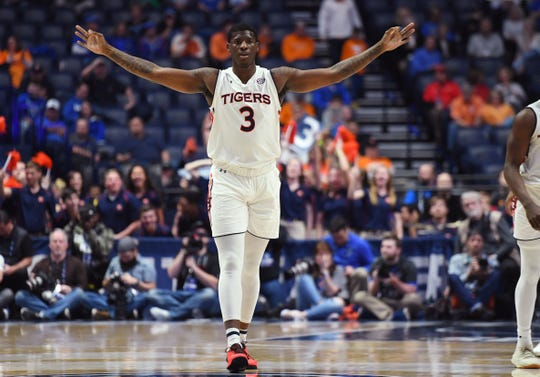 Auburn forward Danjel Purifoy (3) celebrates after scoring against Florida in the SEC Tournament at Bridgestone Arena on March 16, 2019, in Nashville, Tennessee.