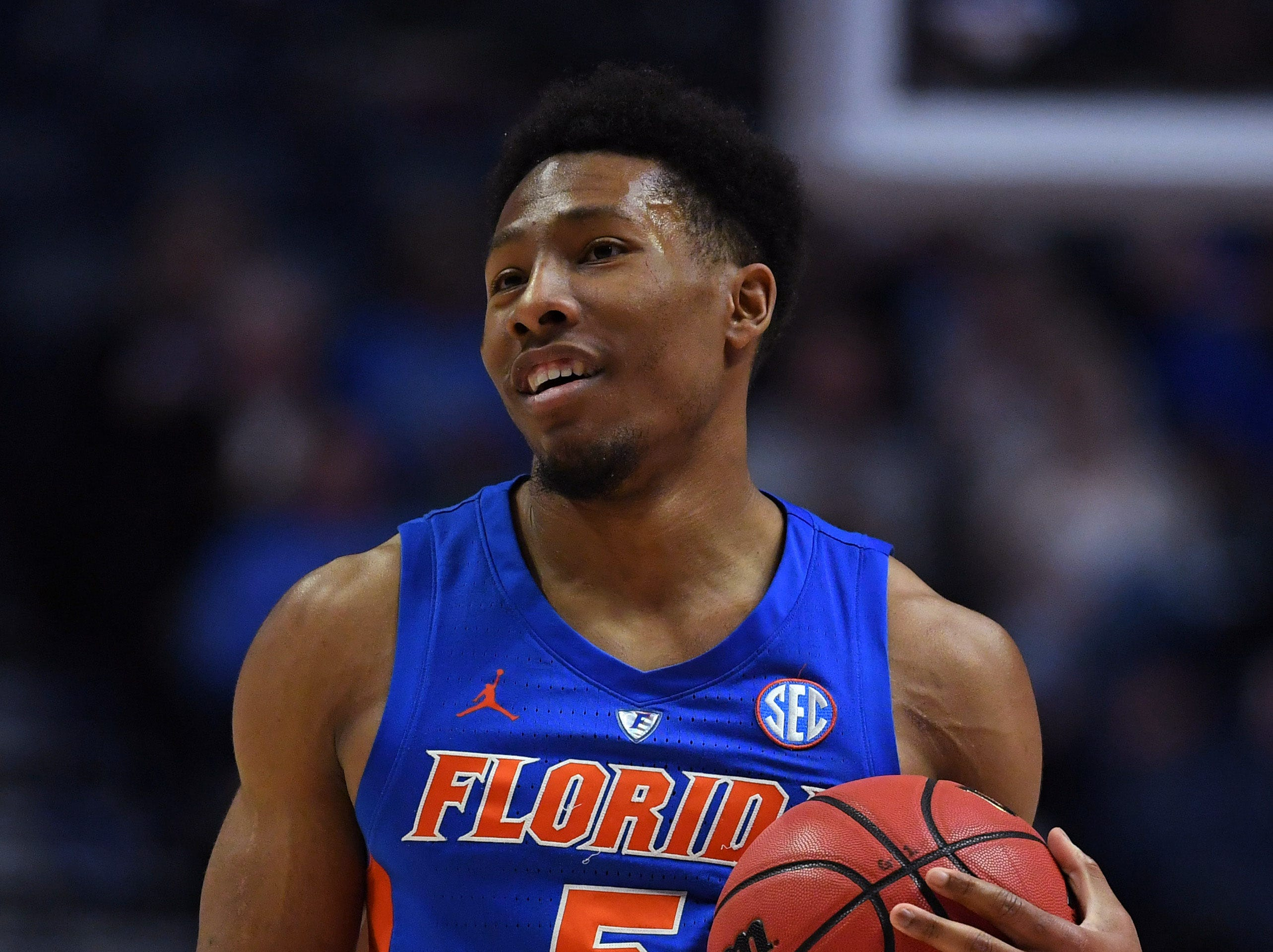 Mar 16, 2019; Nashville, TN, USA; Florida Gators guard KeVaughn Allen (5) looks on from the court during the first half against the Auburn Tigers in the SEC conference tournament at Bridgestone Arena. Mandatory Credit: Christopher Hanewinckel-USA TODAY Sports