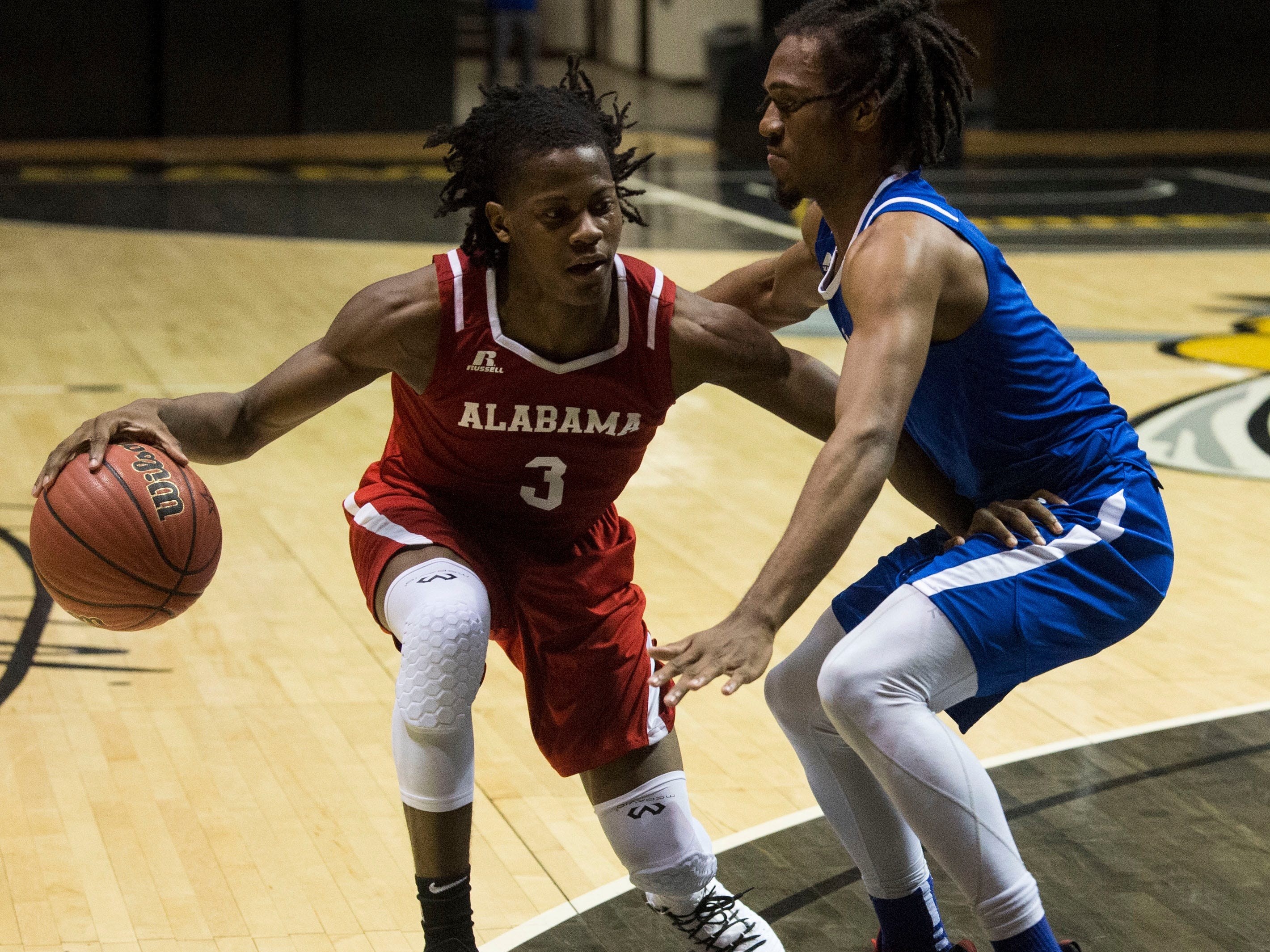 Alabama's Cameron Tucker (3) dribbles the ball during the Alabama-Mississippi All-Star game at the Dunn-Oliver Acadome in Montgomery, Ala., on Friday, March 15, 2019. Alabama All-stars defeated the Mississippi All-stars 107-90.