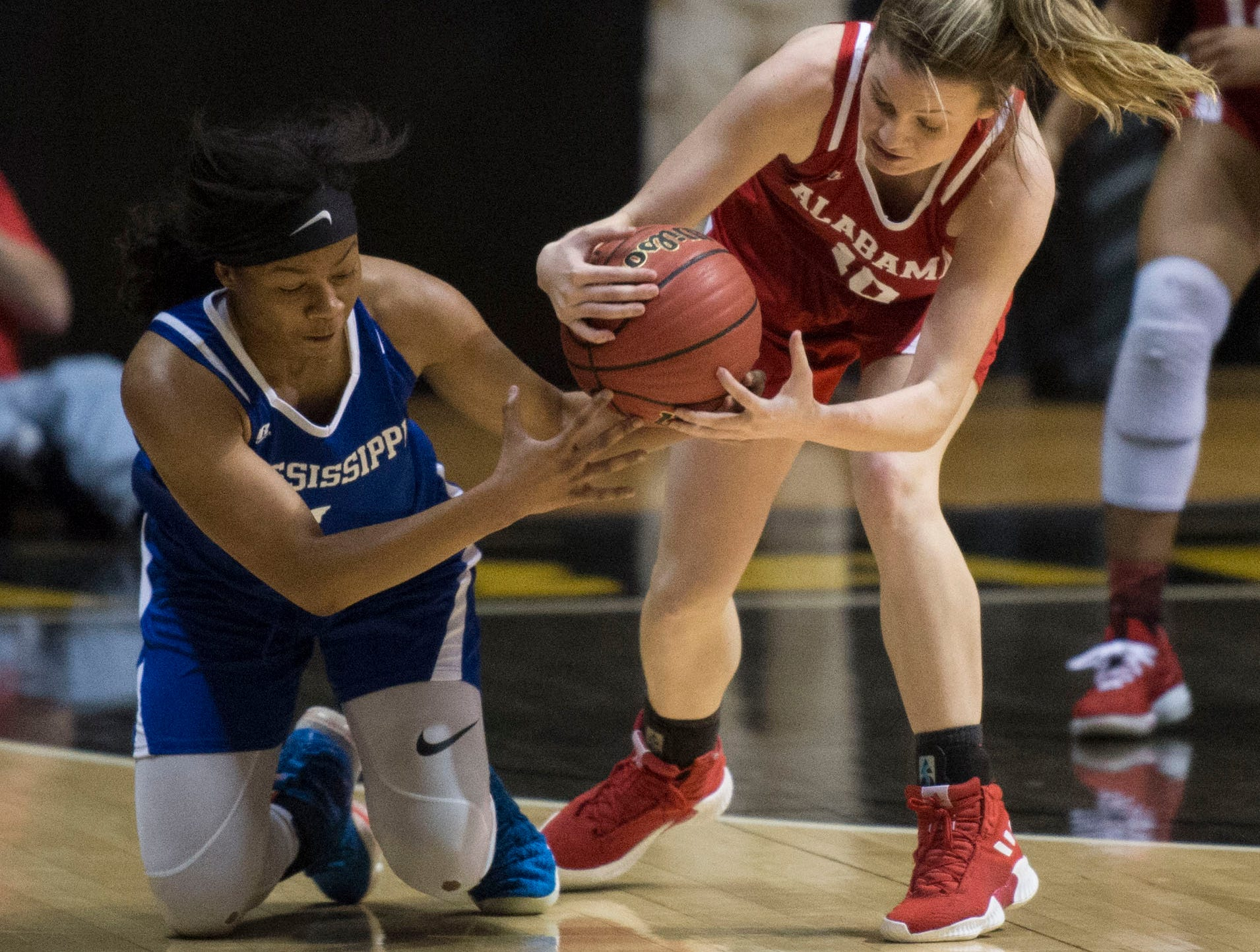 Mississippi's Sania Wells (1) and Alabama's Annie Hughes (10) fight for a loose ball during the Alabama-Mississippi All-Star game at the Dunn-Oliver Acadome in Montgomery, Ala., on Friday, March 15, 2019. Alabama All-stars defeated the Mississippi All-stars 101-82.