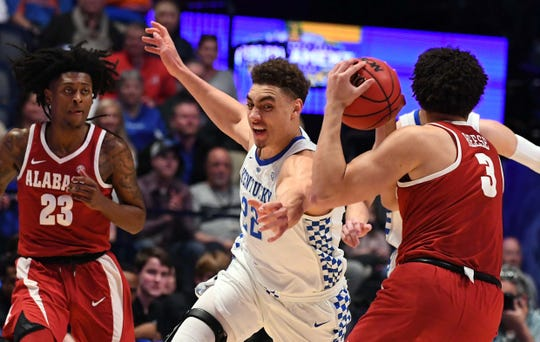 Mar 15, 2019; Nashville, TN, USA; Kentucky Wildcats forward Reid Travis (22) misses on a steal on Alabama Crimson Tide forward Alex Reese (3) during the first half of the SEC conference tournament at Bridgestone Arena. Mandatory Credit: Christopher Hanewinckel-USA TODAY Sports