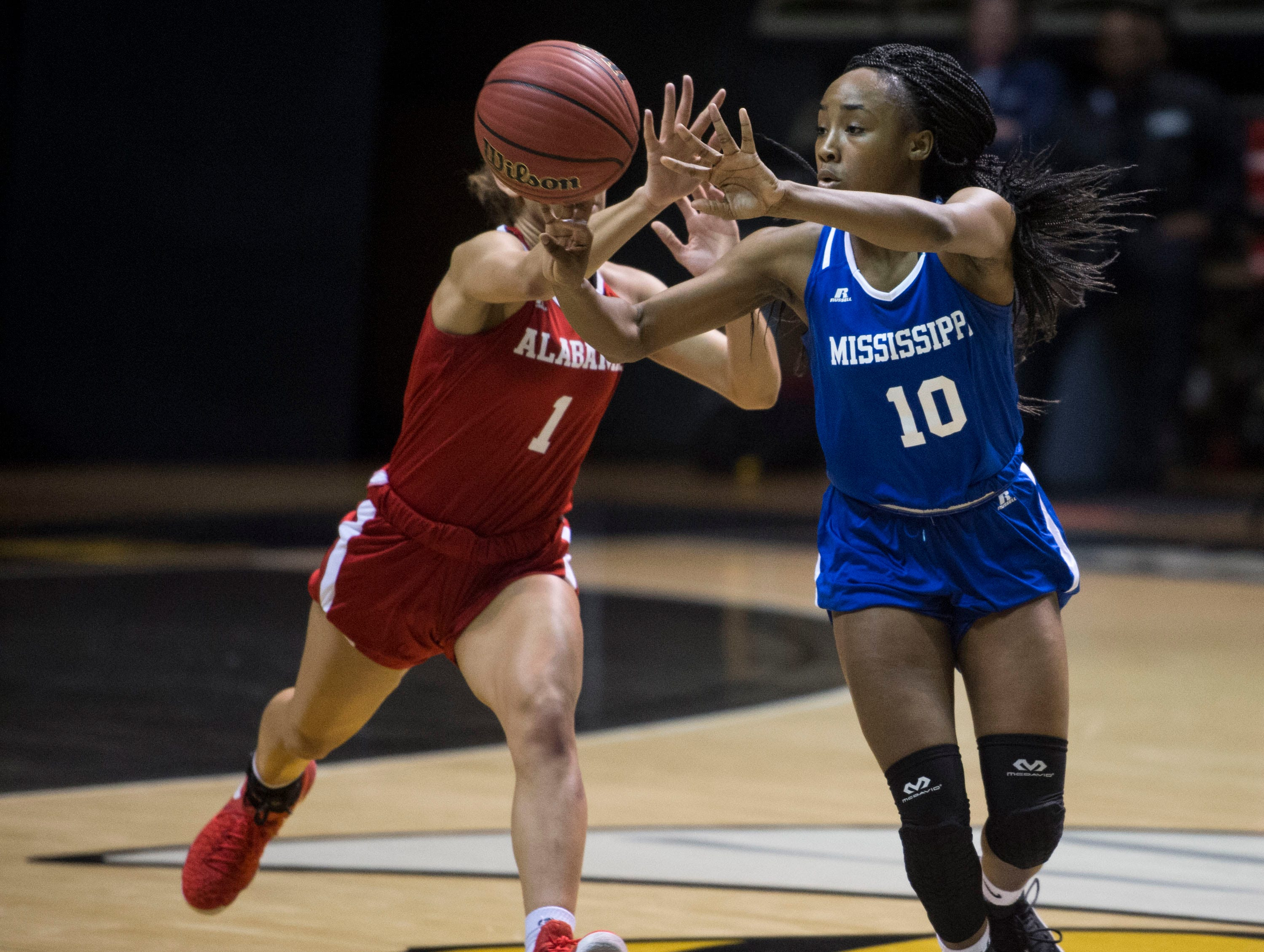 Mississippi's Hannah White (10) passes the ball before Alabama's Skyla Knight (1) steals it during the Alabama-Mississippi All-Star game at the Dunn-Oliver Acadome in Montgomery, Ala., on Friday, March 15, 2019. Alabama All-stars defeated the Mississippi All-stars 101-82.