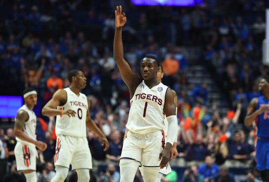 Auburn Jared Harper (1) celebrates after making a go-ahead 3-pointer late in the second half against Florida in the SEC Tournament on March 16, 2019.