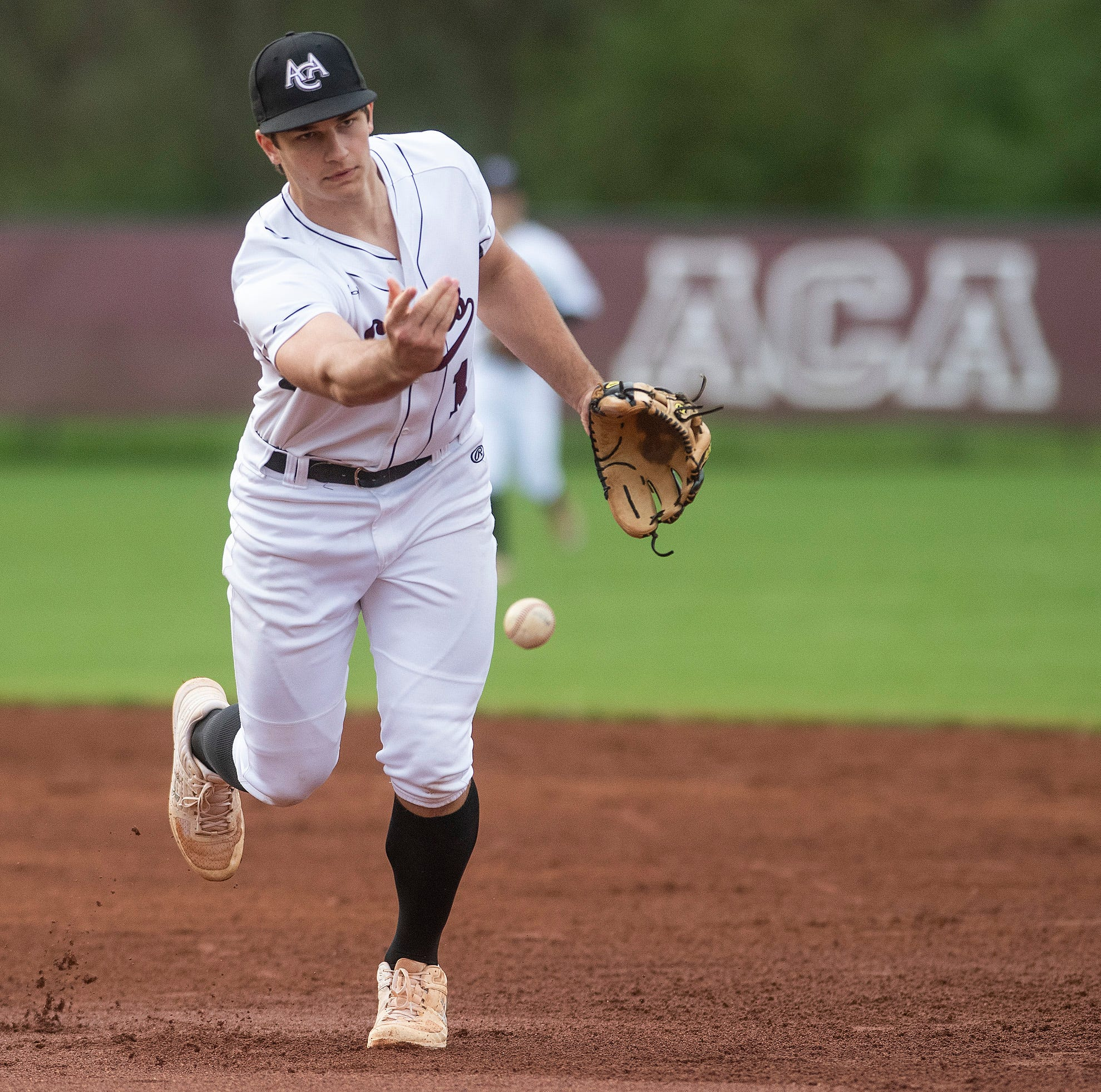 Alabama Christian Academy's Reece Solar tosses the ball to first against Prattville Christian Academy In Montgomery, Ala., on Friday March 15, 2019.