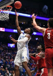 Mar 15, 2019; Nashville, TN, USA; Kentucky Wildcats guard Ashton Hagans (2) scores in the lane against the Alabama Crimson Tide during the first half of the SEC conference tournament at Bridgestone Arena. Mandatory Credit: Christopher Hanewinckel-USA TODAY Sports