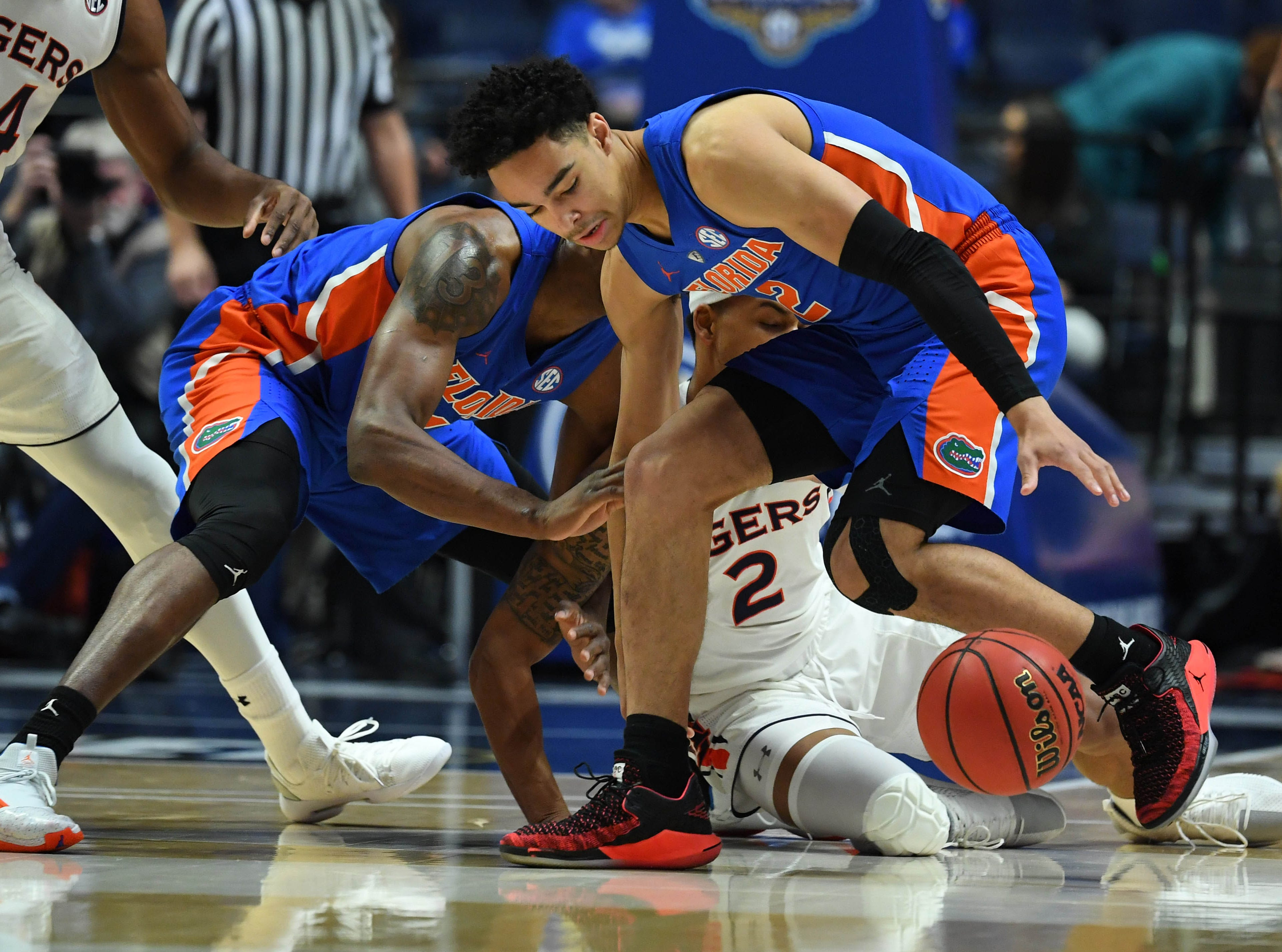 Mar 16, 2019; Nashville, TN, USA; Florida Gators guard Andrew Nembhard (2) chases after the ball following a steal attempt from Auburn Tigers guard Bryce Brown (2) during the first half  of the SEC conference tournament at Bridgestone Arena. Mandatory Credit: Christopher Hanewinckel-USA TODAY Sports