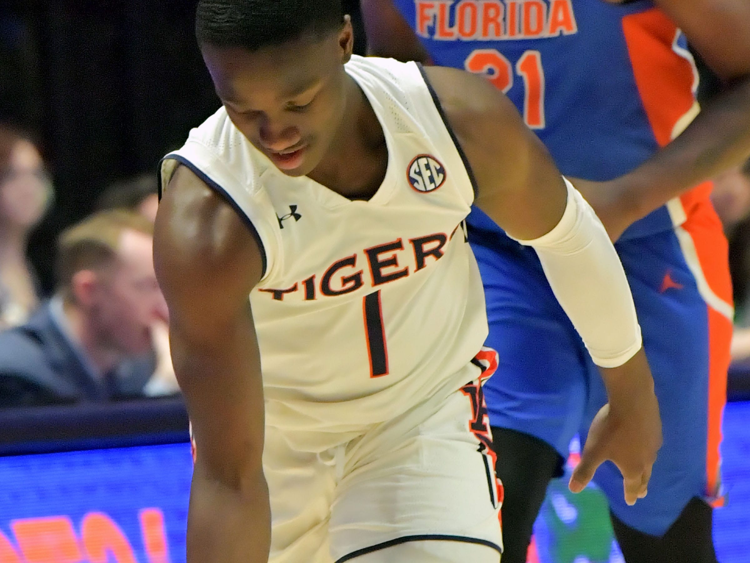 Mar 16, 2019; Nashville, TN, USA; Auburn Tigers guard Jared Harper (1) reacts after scoring a three pint shot against the Florida Gators during the first half of game eleven in the SEC conference tournament at Bridgestone Arena. Mandatory Credit: Jim Brown-USA TODAY Sports