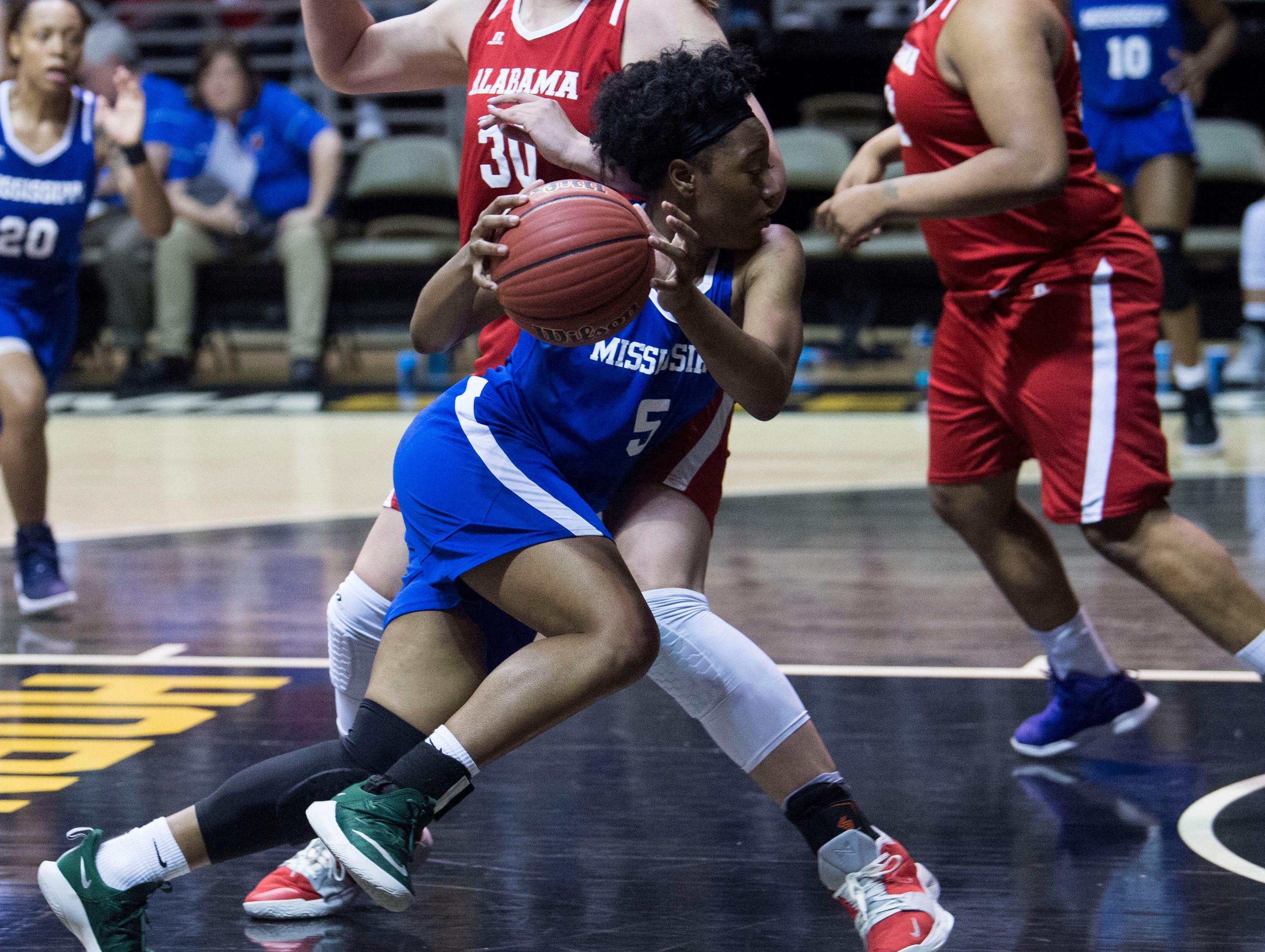 Mississippi's Ebony Gayden (5) drives to the basket on Alabama's River Baldwin (30) during the Alabama-Mississippi All-Star game at the Dunn-Oliver Acadome in Montgomery, Ala., on Friday, March 15, 2019. Alabama All-stars defeated the Mississippi All-stars 101-82.