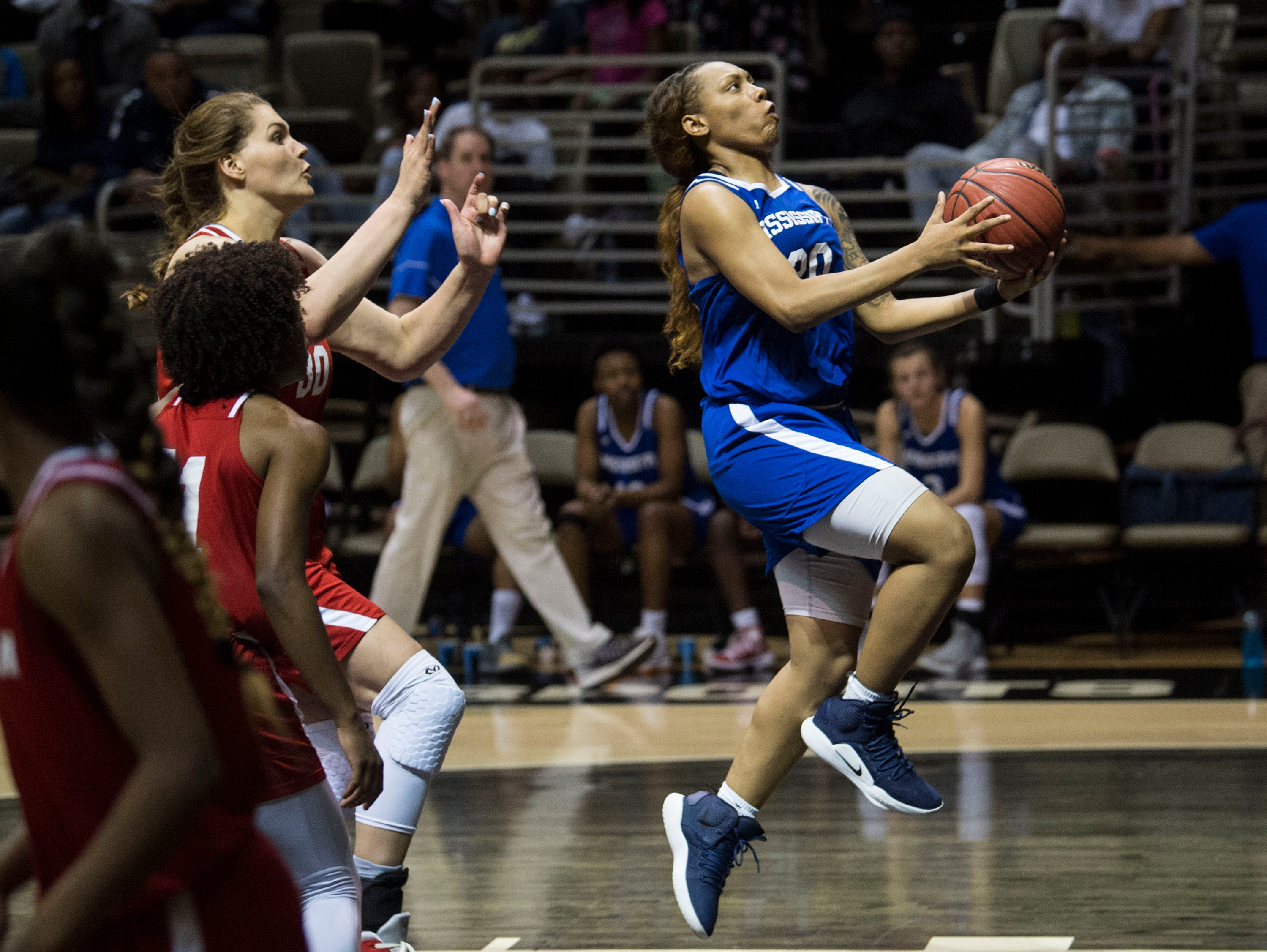 Mississippi's Jayla Alexander (20) goes up for a layup during the Alabama-Mississippi All-Star game at the Dunn-Oliver Acadome in Montgomery, Ala., on Friday, March 15, 2019. Alabama All-stars defeated the Mississippi All-stars 101-82.