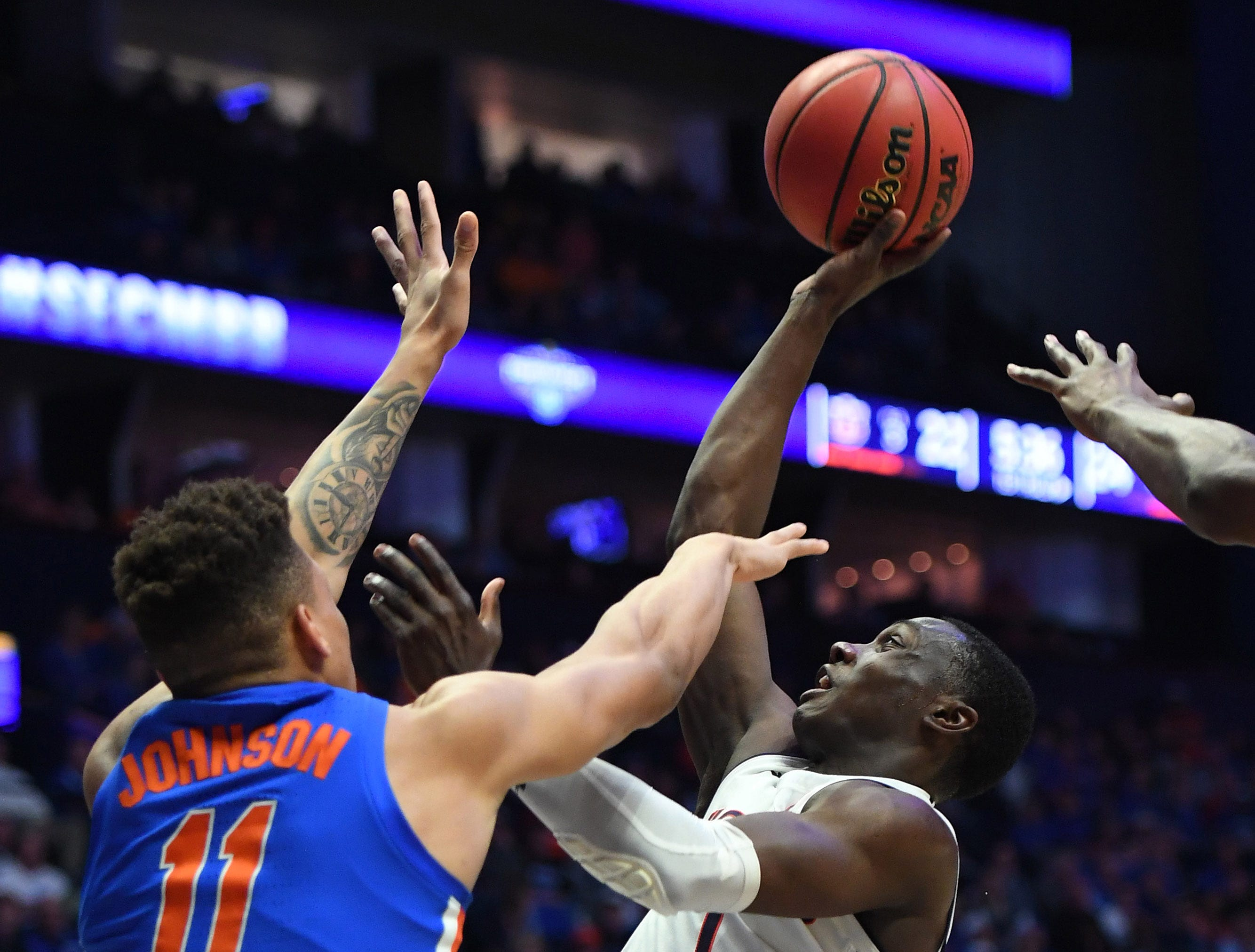 Mar 16, 2019; Nashville, TN, USA; Auburn Tigers guard Jared Harper (1) shoots the ball as Florida Gators forward Keyontae Johnson (11) defends during the first half of the SEC conference tournament at Bridgestone Arena. Mandatory Credit: Christopher Hanewinckel-USA TODAY Sports