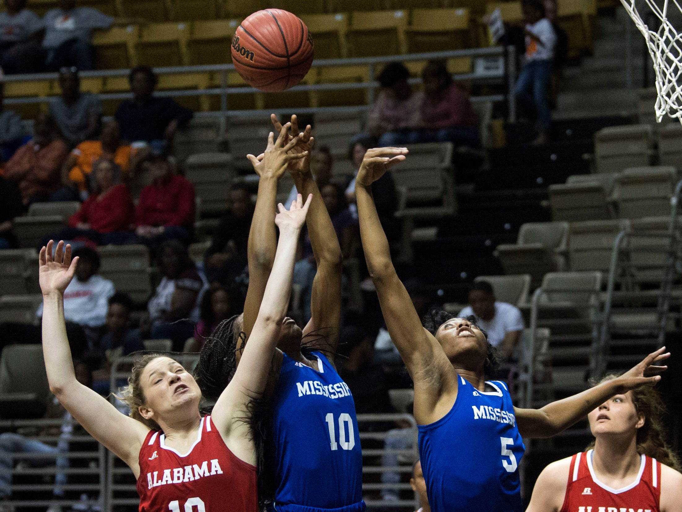 Alabama's Annie Hughes (10), from left, Mississippi's Hannah White (10) and Ebony Gayden (5) go up for a rebound during the Alabama-Mississippi All-Star game at the Dunn-Oliver Acadome in Montgomery, Ala., on Friday, March 15, 2019. Alabama All-stars defeated the Mississippi All-stars 101-82.