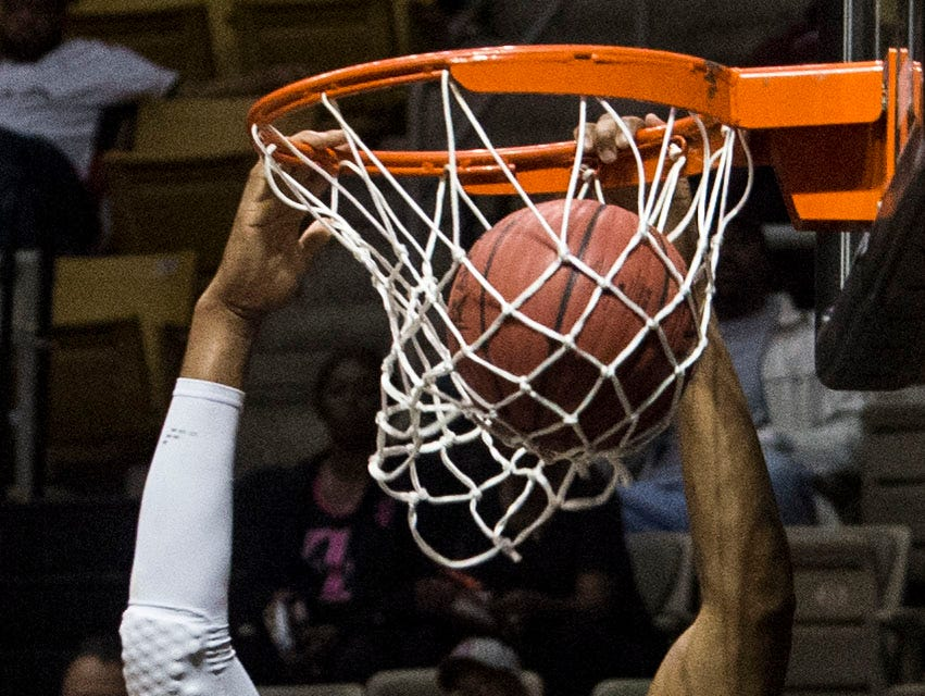 Alabama's Demond Robinson (22) dunks the ball during the Alabama-Mississippi All-Star game at the Dunn-Oliver Acadome in Montgomery, Ala., on Friday, March 15, 2019. Mississippi All-stars leads the Alabama All-stars 47-39 at halftime.