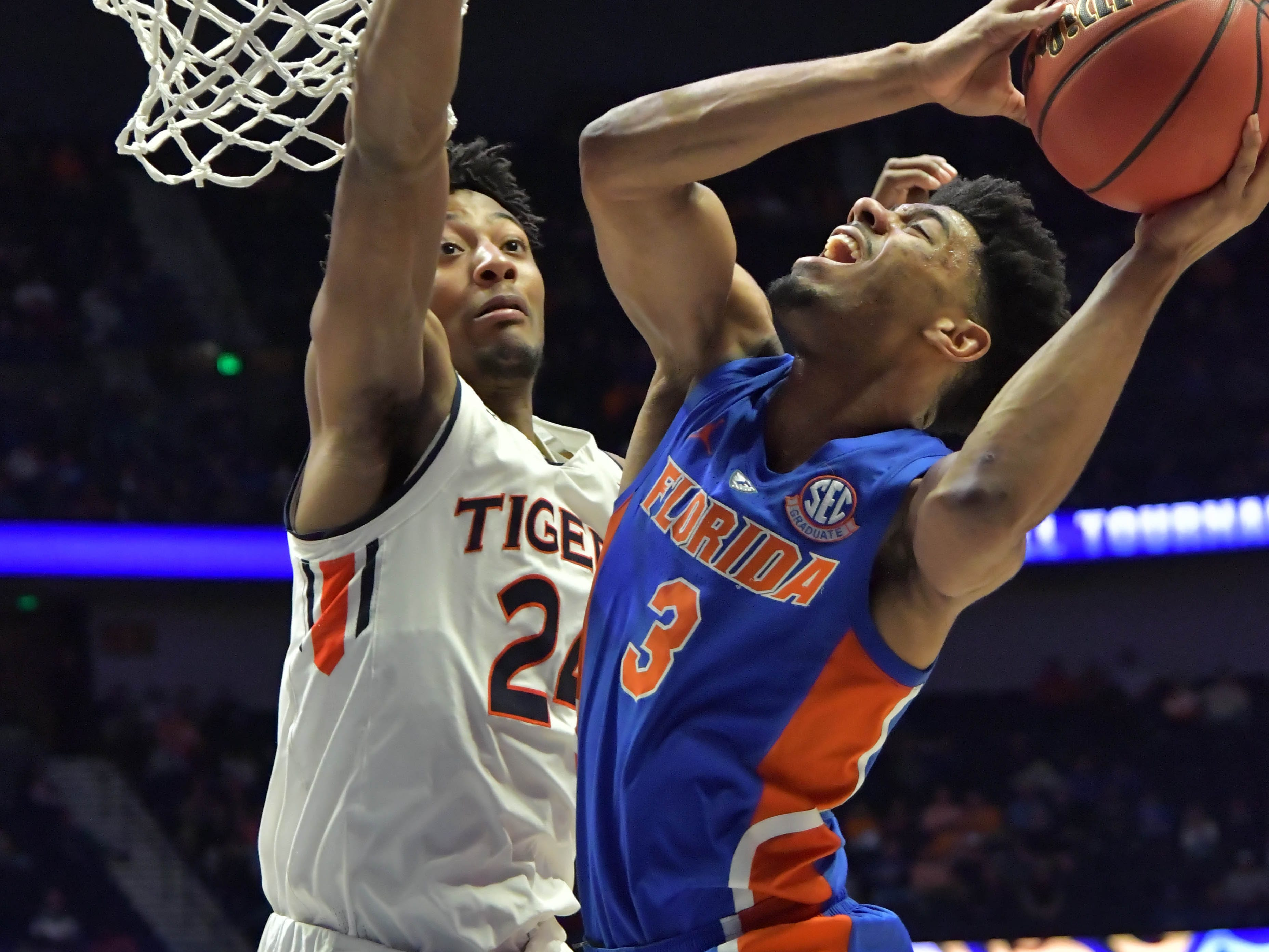 Mar 16, 2019; Nashville, TN, USA; Florida Gators guard Jalen Hudson (3) shoots against Auburn Tigers forward Anfernee McLemore (24) during the first half of game eleven in the SEC conference tournament at Bridgestone Arena. Mandatory Credit: Jim Brown-USA TODAY Sports