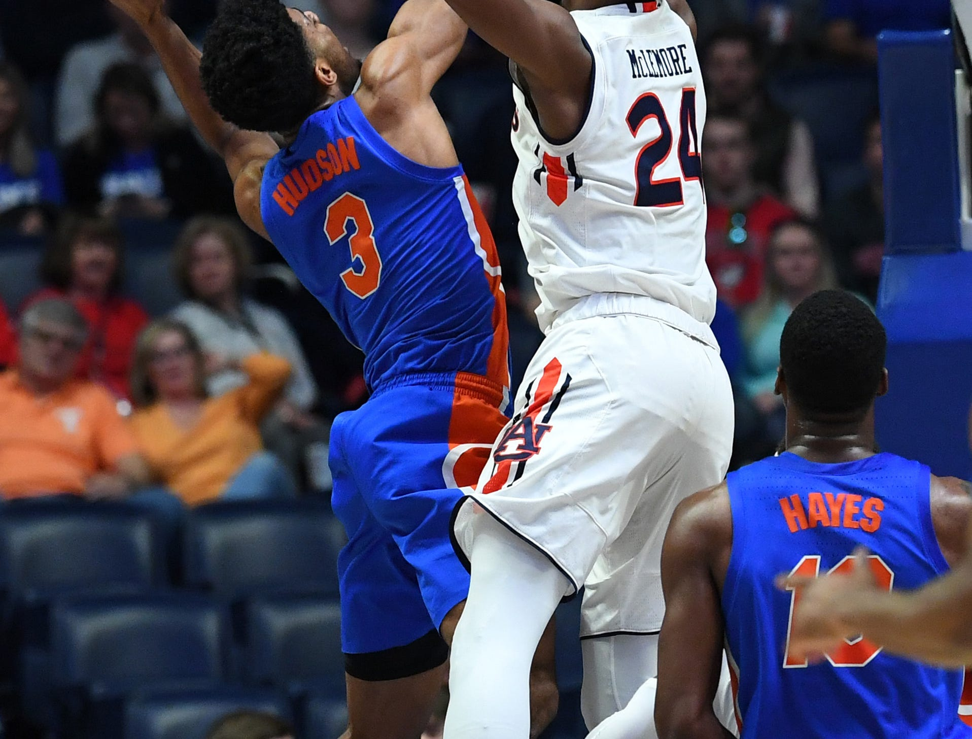 Mar 16, 2019; Nashville, TN, USA; Florida Gators guard Jalen Hudson (3) is fouled by Auburn Tigers forward Anfernee McLemore (24) while shooting the ball during the first half of the SEC conference tournament at Bridgestone Arena. Mandatory Credit: Christopher Hanewinckel-USA TODAY Sports