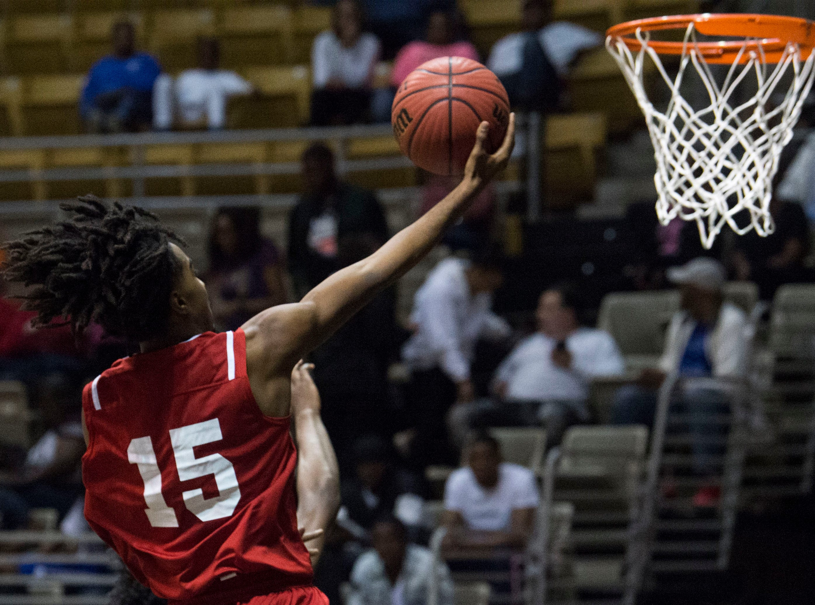 Alabama's Brandon Nicholas (15) goes up for a layup during the Alabama-Mississippi All-Star game at the Dunn-Oliver Acadome in Montgomery, Ala., on Friday, March 15, 2019. Mississippi All-stars leads the Alabama All-stars 47-39 at halftime.