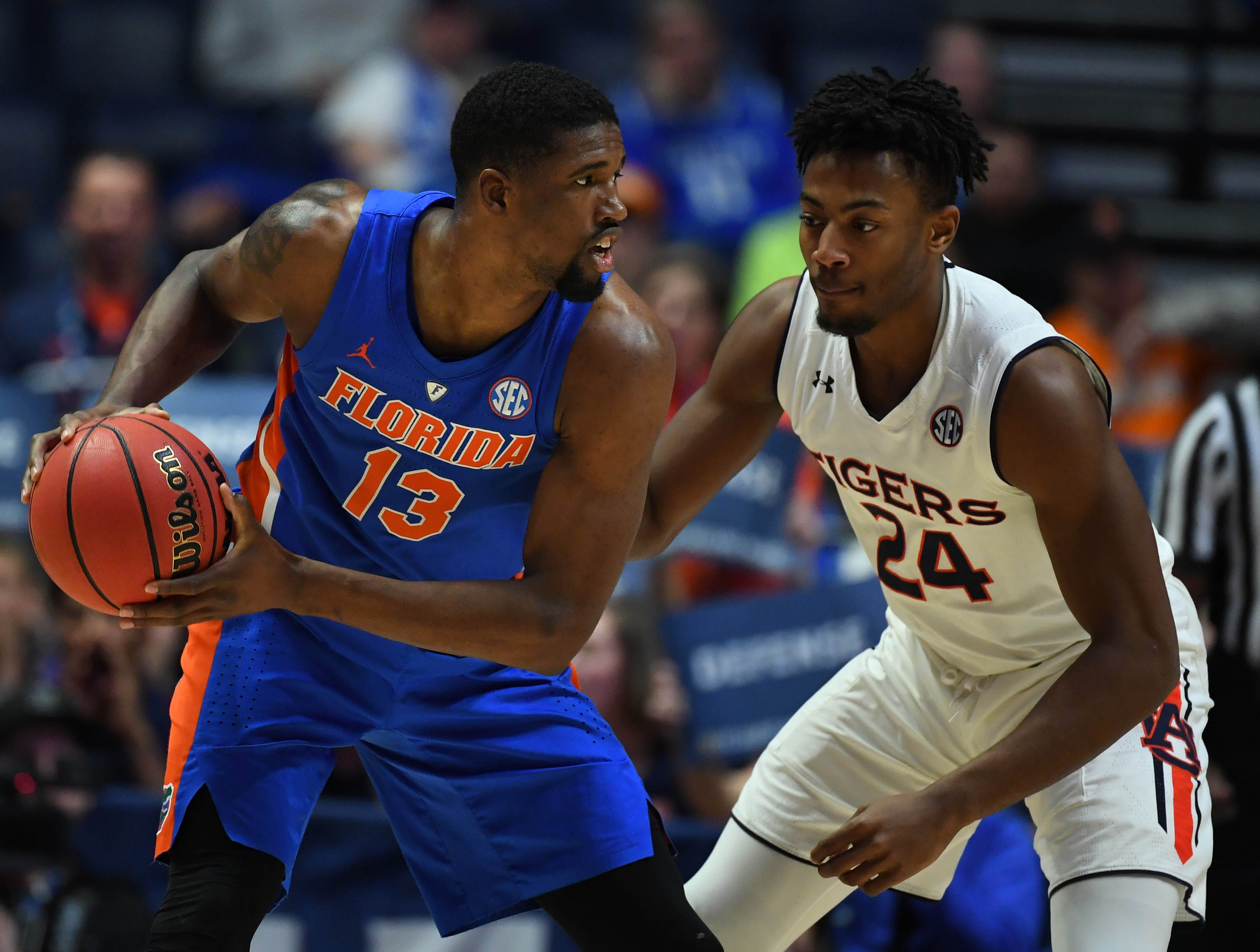 Mar 16, 2019; Nashville, TN, USA; Florida Gators center Kevarrius Hayes (13) works against Auburn Tigers forward Anfernee McLemore (24) during the first half of the SEC conference tournament at Bridgestone Arena. Mandatory Credit: Christopher Hanewinckel-USA TODAY Sports