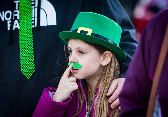 Hundreds of locals gathered along Walnut Street and Mulberry Street for the annual St. Patrick's Day Parade in downtown Muncie Saturday evening.