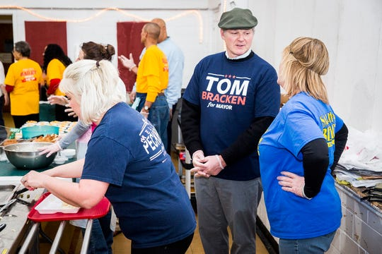 Tom Bracken and other mayoral candidates volunteer at the Delaware County Senior Center during a chicken noodle dinner at the facility.