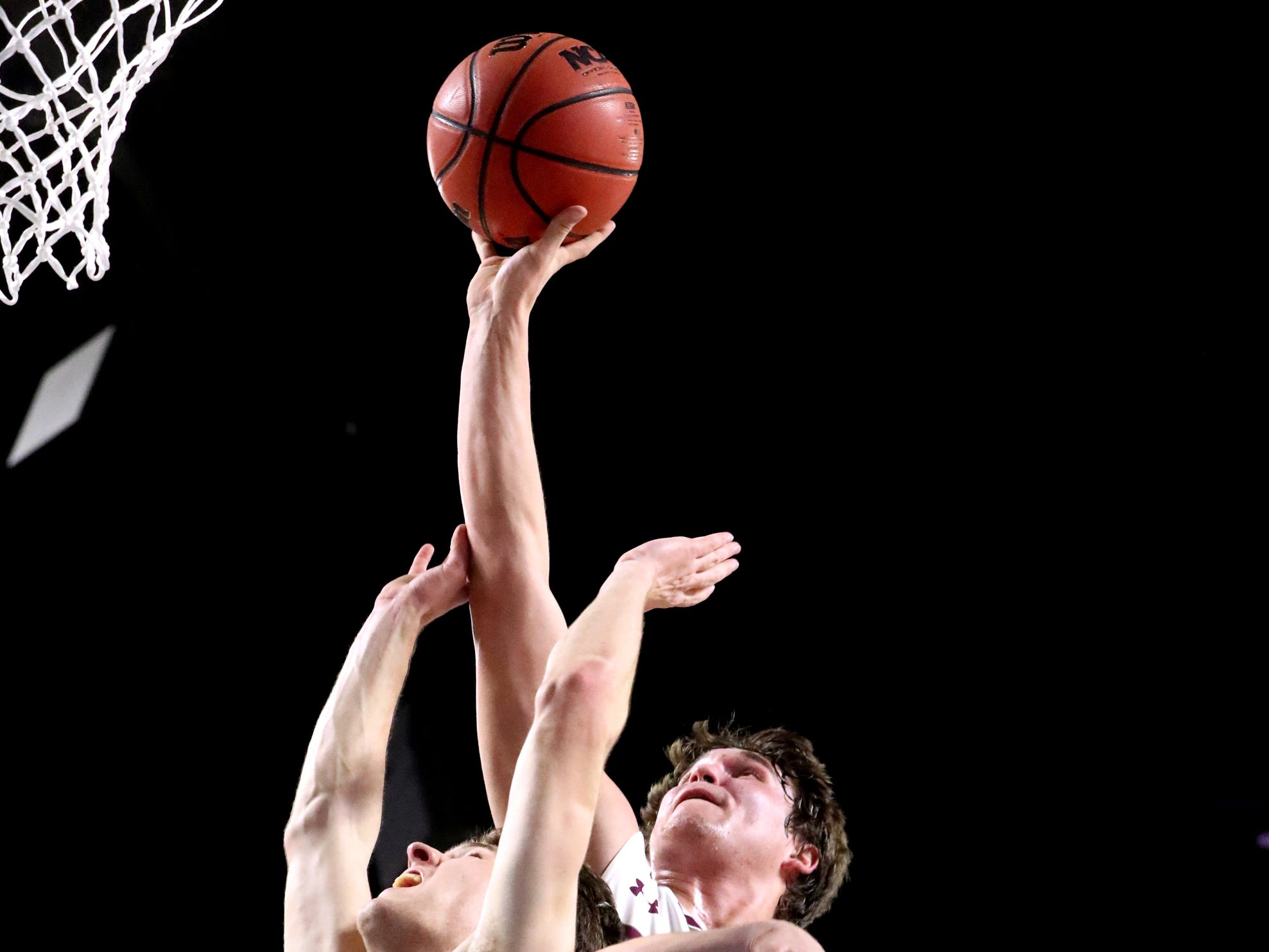 Eagleville's Ethan Cobb (12) tries to get a rebound back in as Columbia Academy's Carson Cary (12) and Andrew Logsdon (2) both guard him during the semifinal round of the TSSAA Class A Boys State Tournament, on Thursday, March 15, 2019, at Murphy Center in Murfreesboro, Tenn.