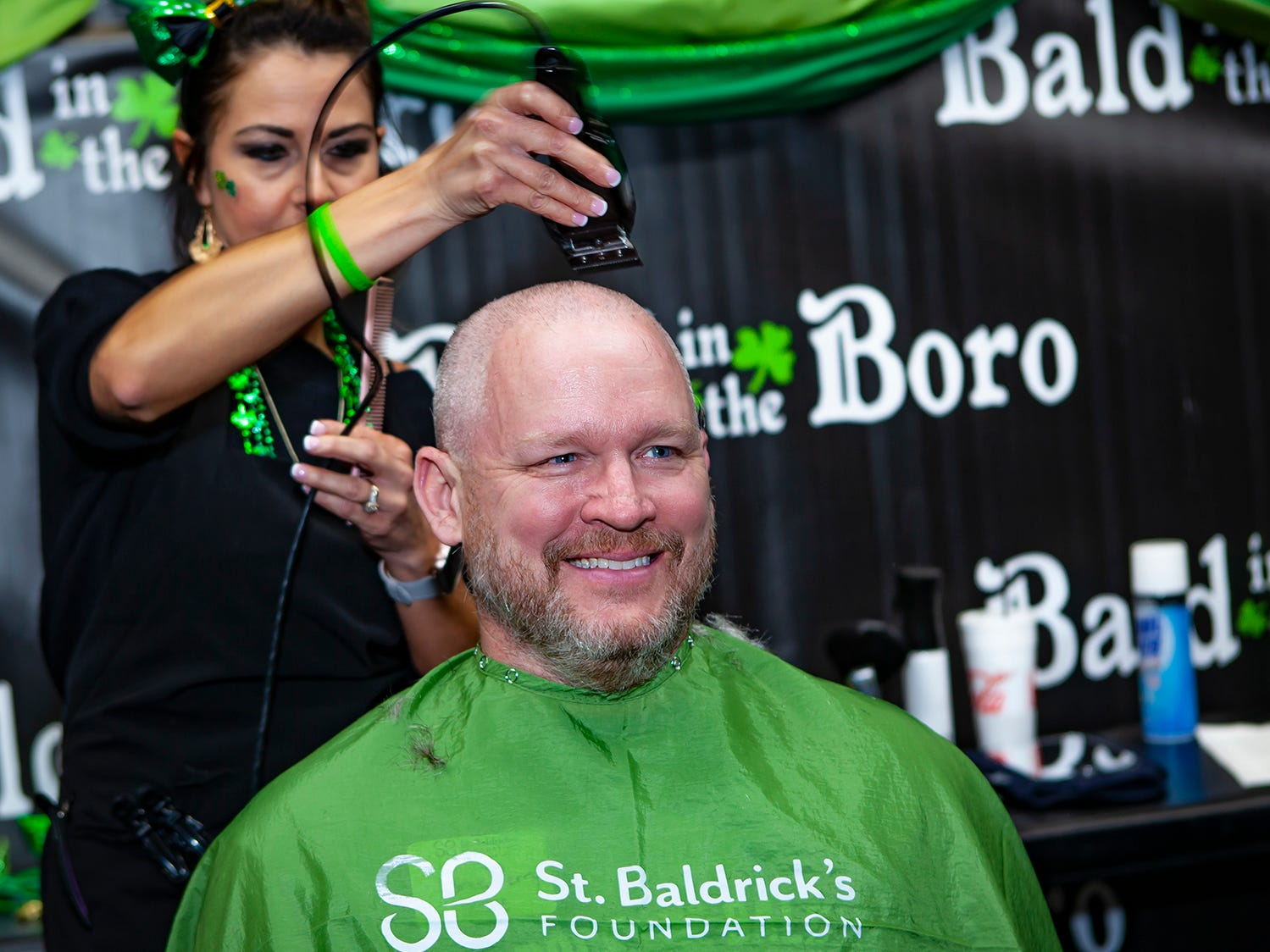 Greg Perry is calm while going under the clippers for the first time at Bald in the Boro. Now in its ninth year, the fundraiser for the St. Baldrick's Foundation was held Friday, March 15, 2019 at Lanes, Trains and Automobiles in Murfreesboro.
