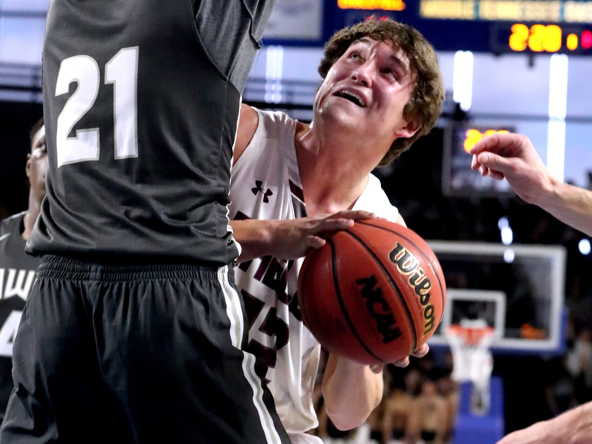 Eagleville's Ethan Cobb (12) shoots the ball as Columbia Academy's Eli Hyle (21) guards him during the semifinal round of the TSSAA Class A Boys State Tournament, on Thursday, March 15, 2019, at Murphy Center in Murfreesboro, Tenn.