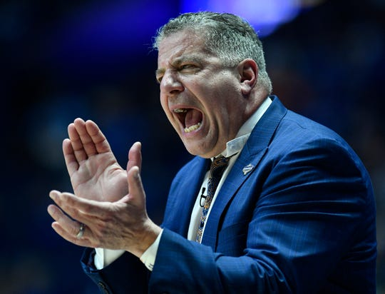 Auburn Head Coach Bruce Pearl yells instructions to his team during the first half of the SEC Men's Basketball Tournament game against Florida at Bridgestone Arena in Nashville, Tenn., Saturday, March 16, 2019.